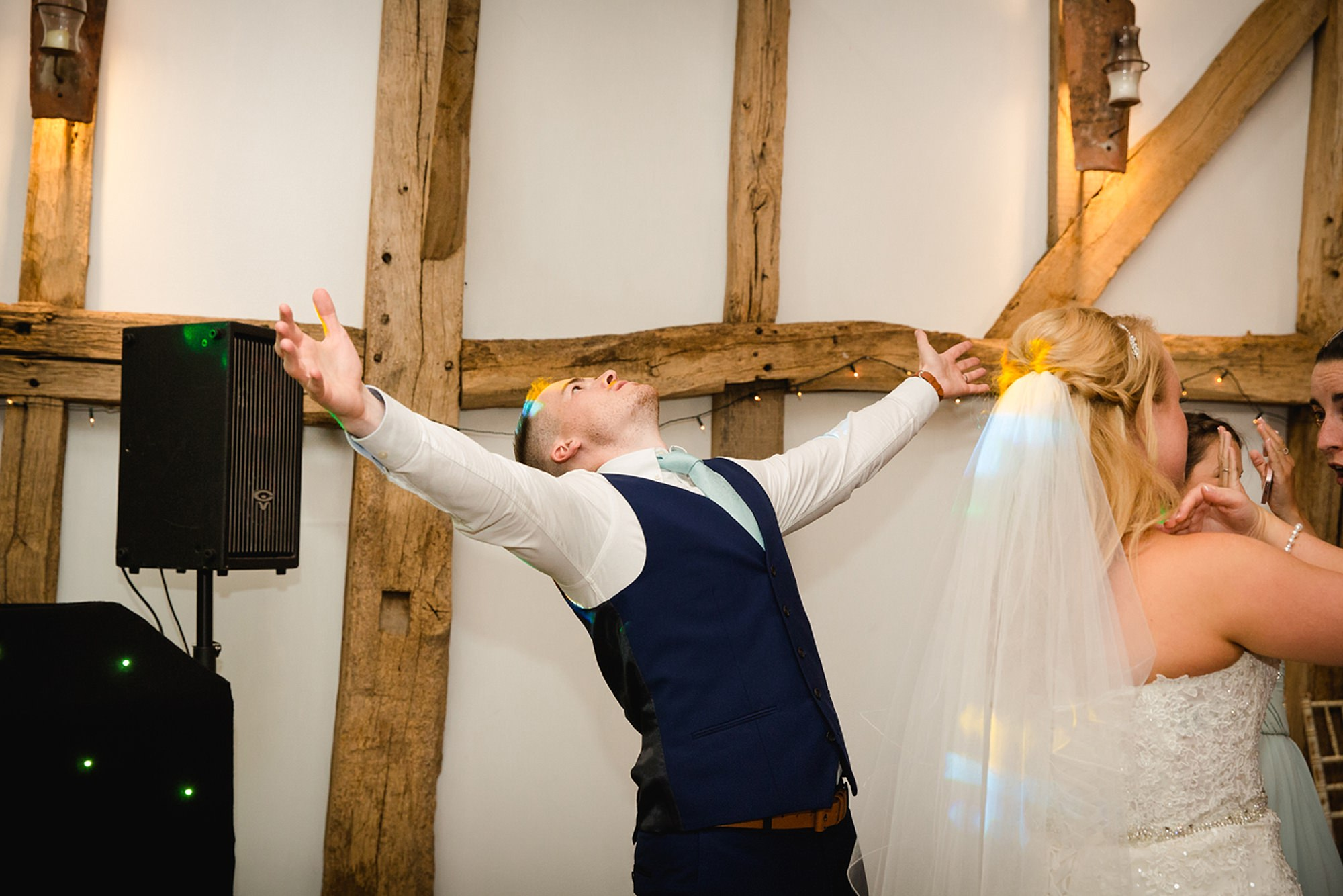 Old Greens Barn Newdigate wedding photography fun groom dance
