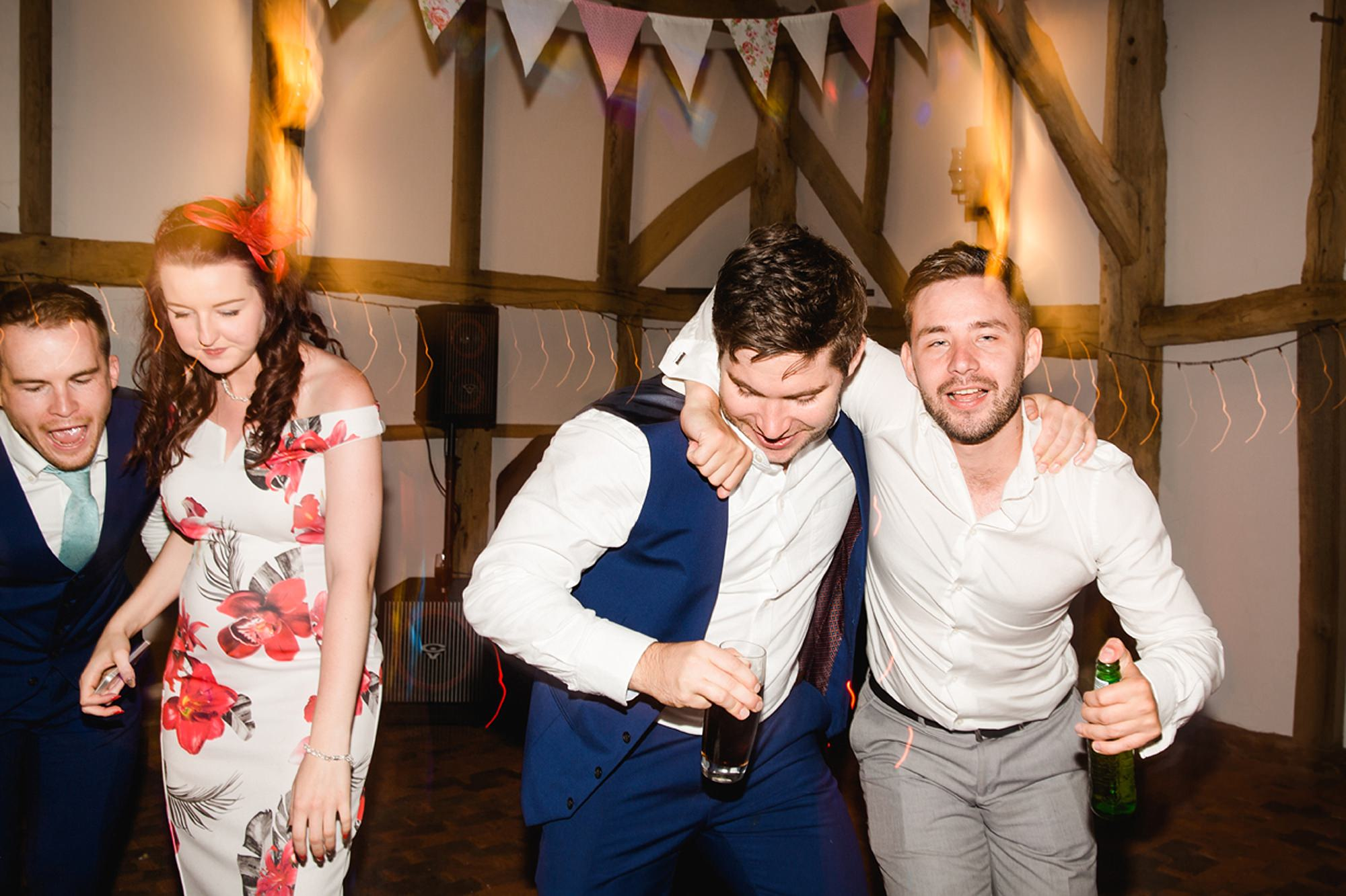 Old Greens Barn Newdigate wedding photography dancing guests