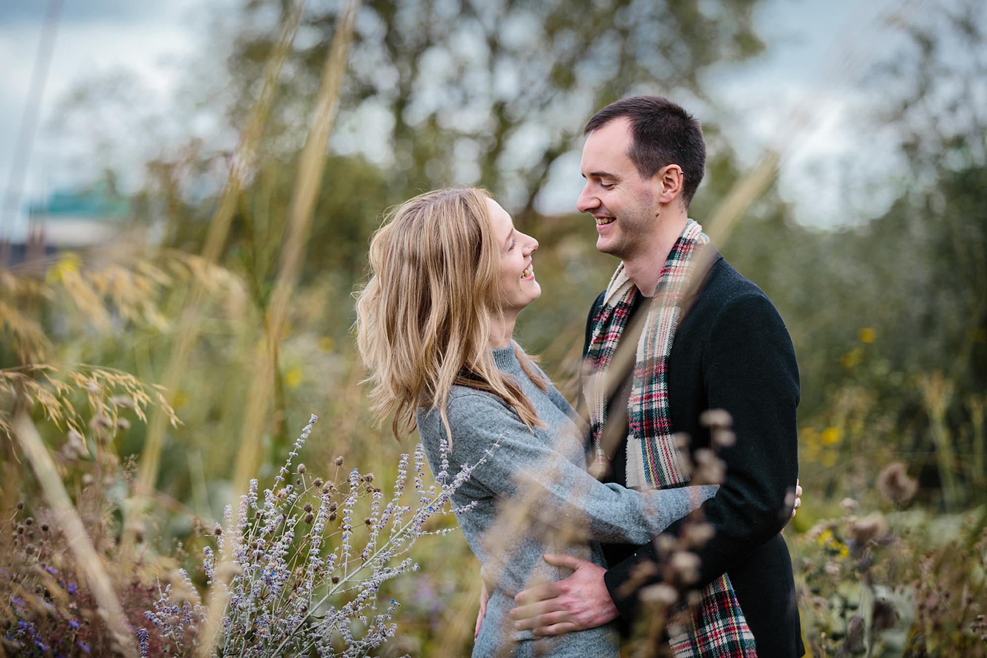 Oxford engagement photography couple in long grass