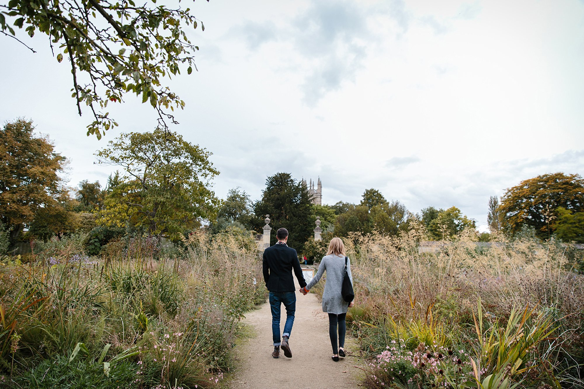 Oxford engagement photography couple walking through gardens
