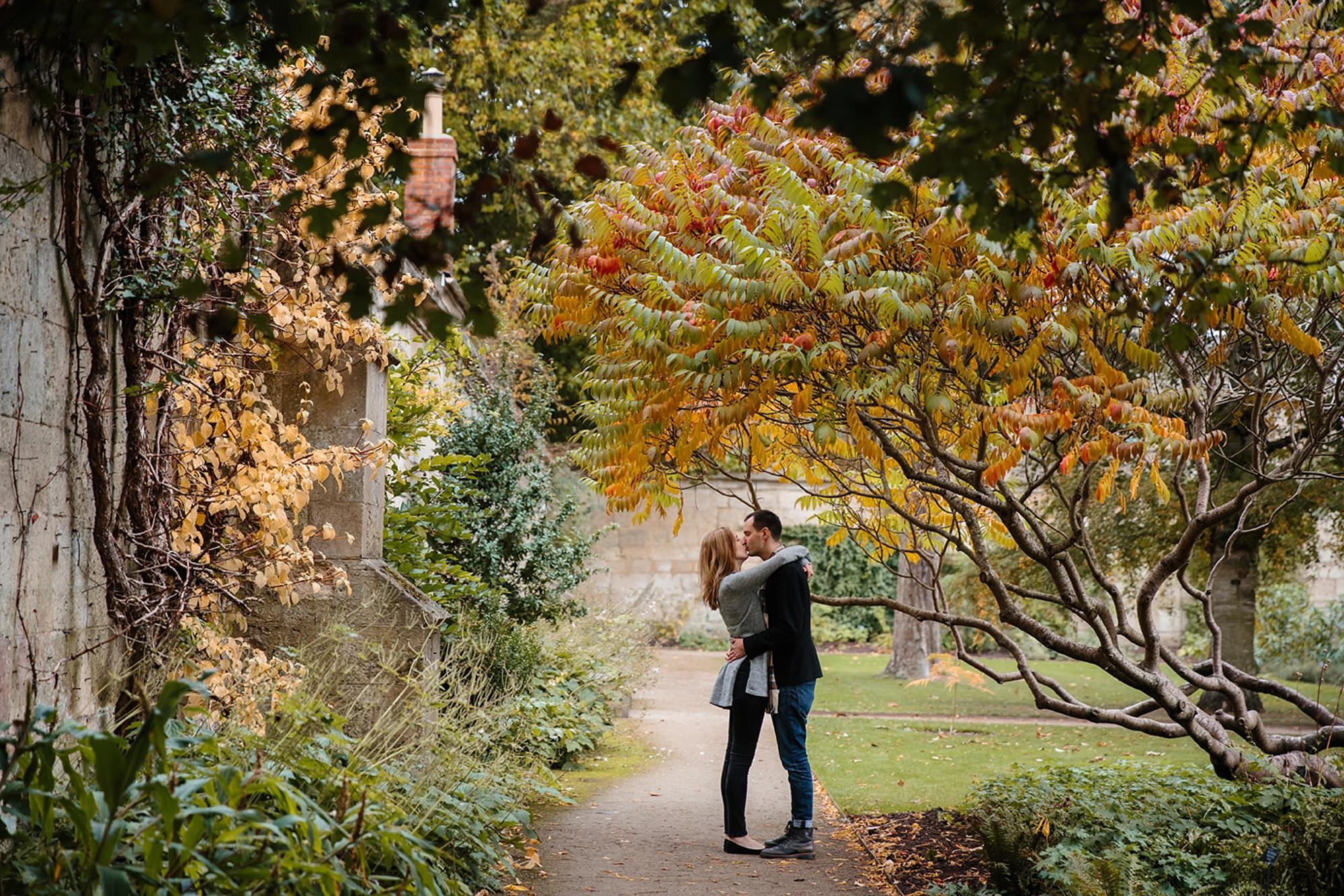 Oxford engagement photography couple kissing under tree
