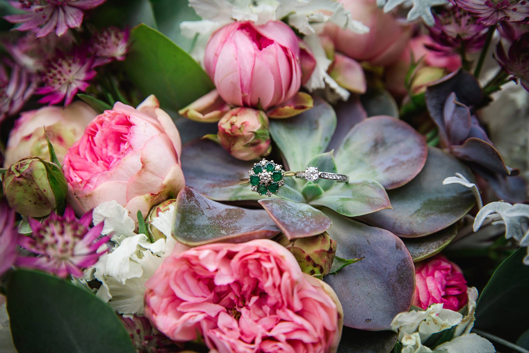 Outdoor humanist wedding photography wedding rings on flowers