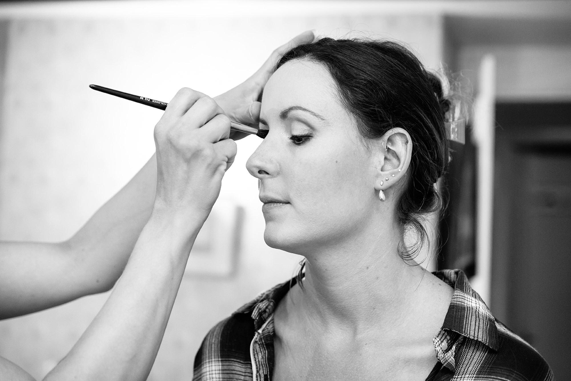 outdoor humanist wedding photography bride having makeup done