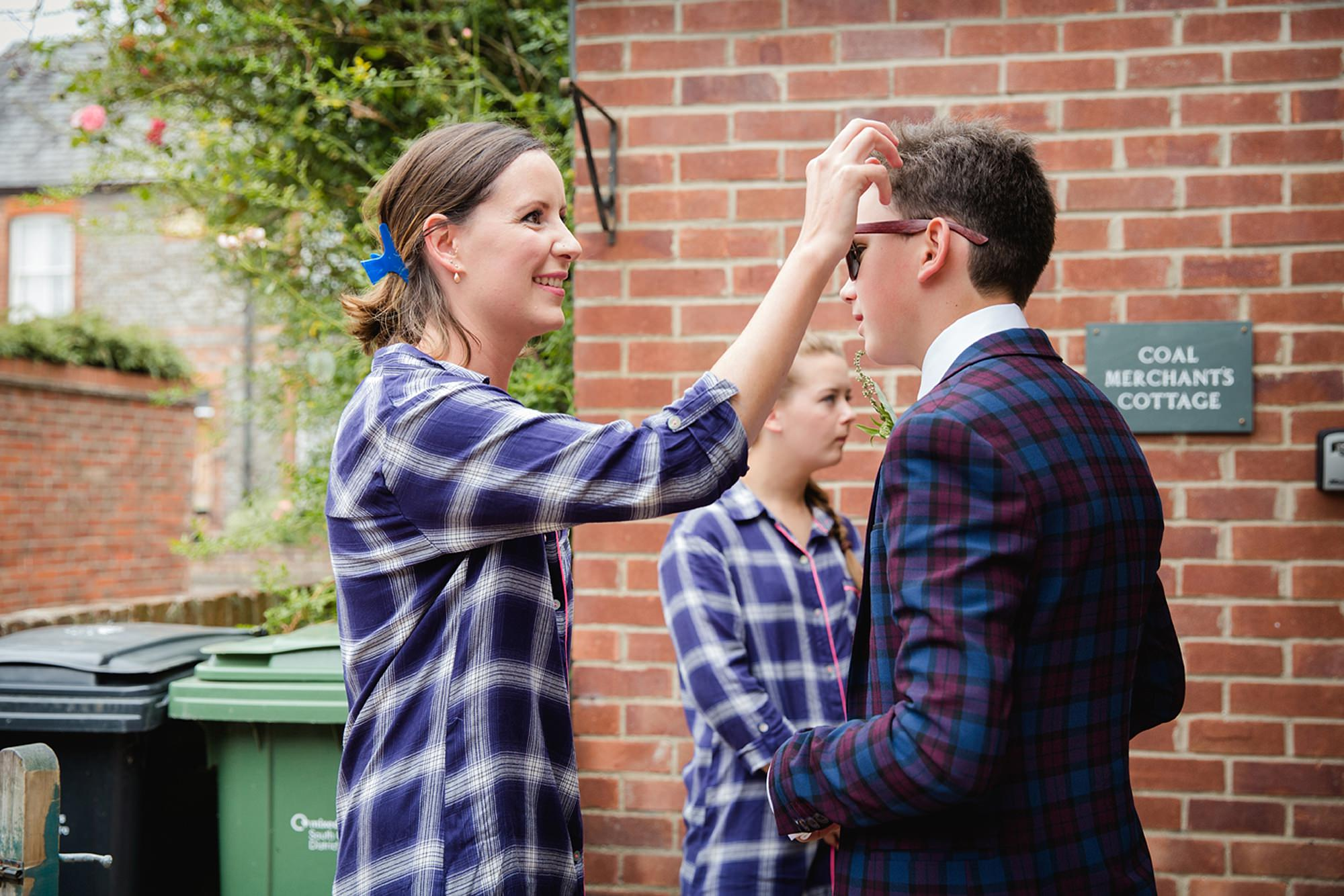 outdoor humanist wedding photography bride doing brother's hair