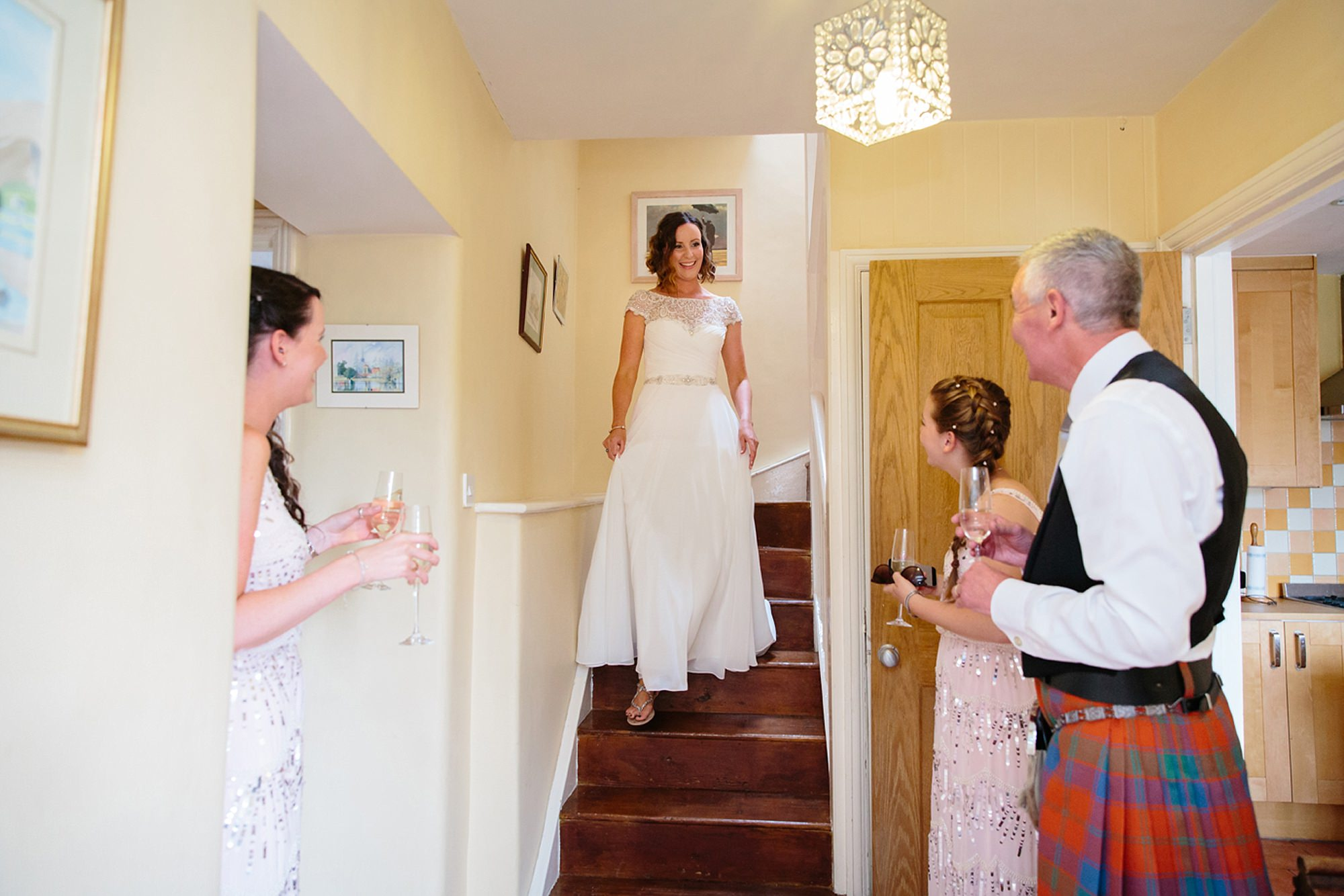 outdoor humanist wedding photography bride coming down stairs