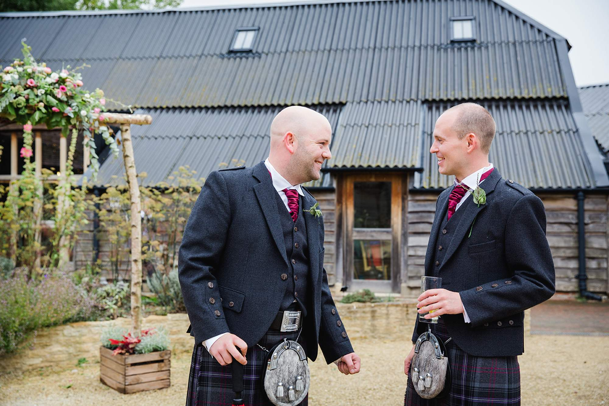 outdoor humanist wedding photography groom waiting with best man