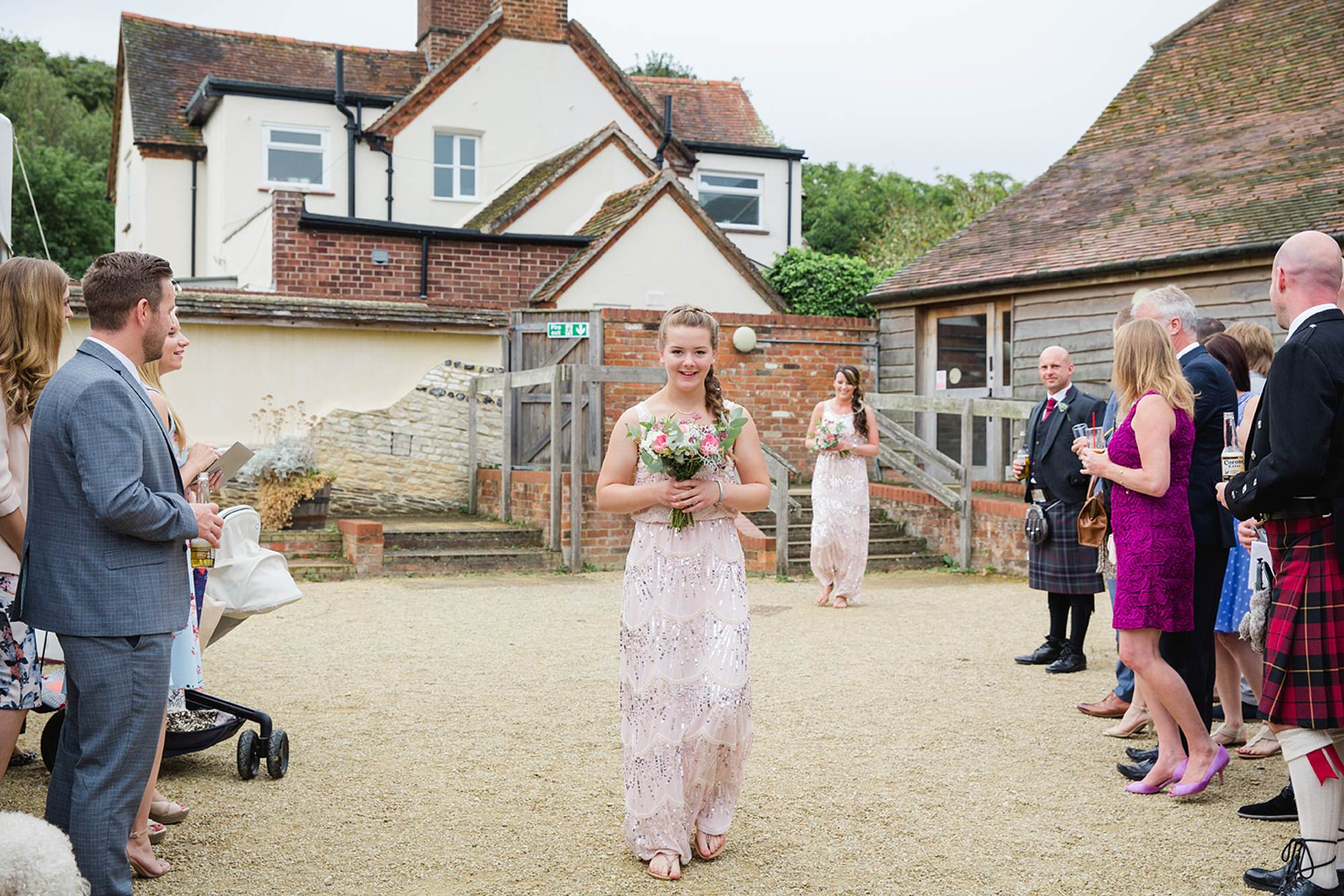 outdoor humanist wedding photography bridesmaid walking to ceremony