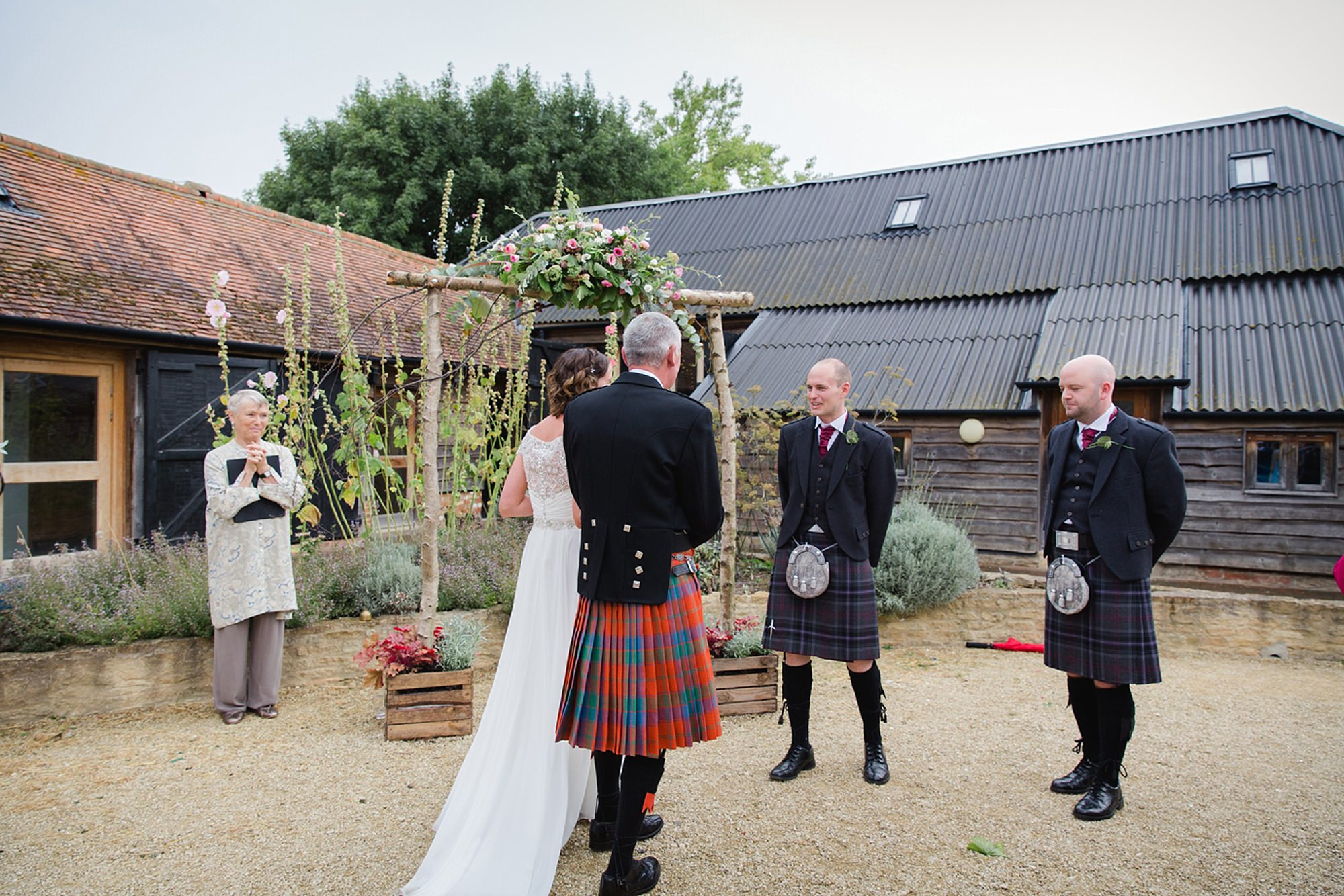 outdoor humanist wedding photography bride greets groom