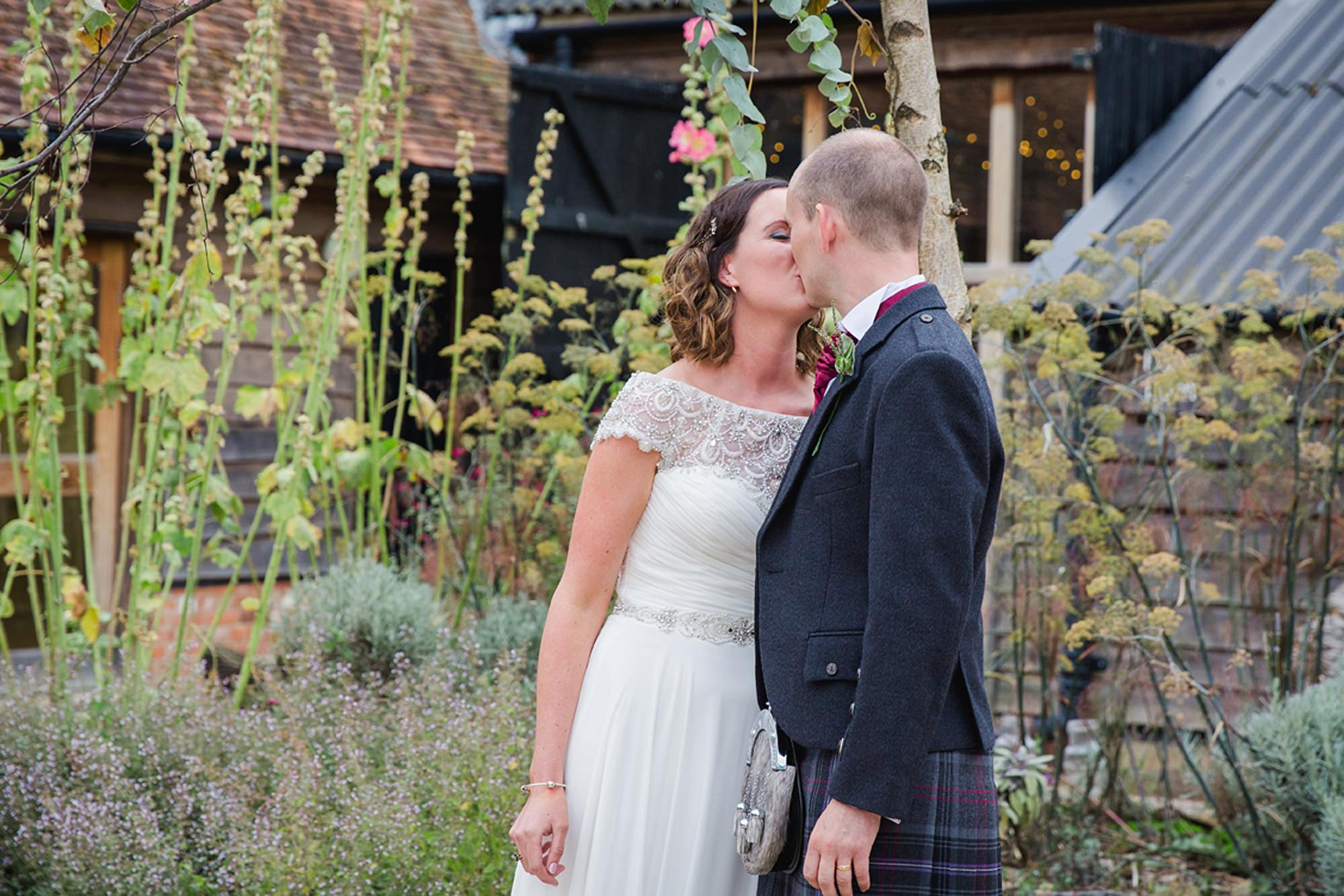 outdoor humanist wedding photography first kiss