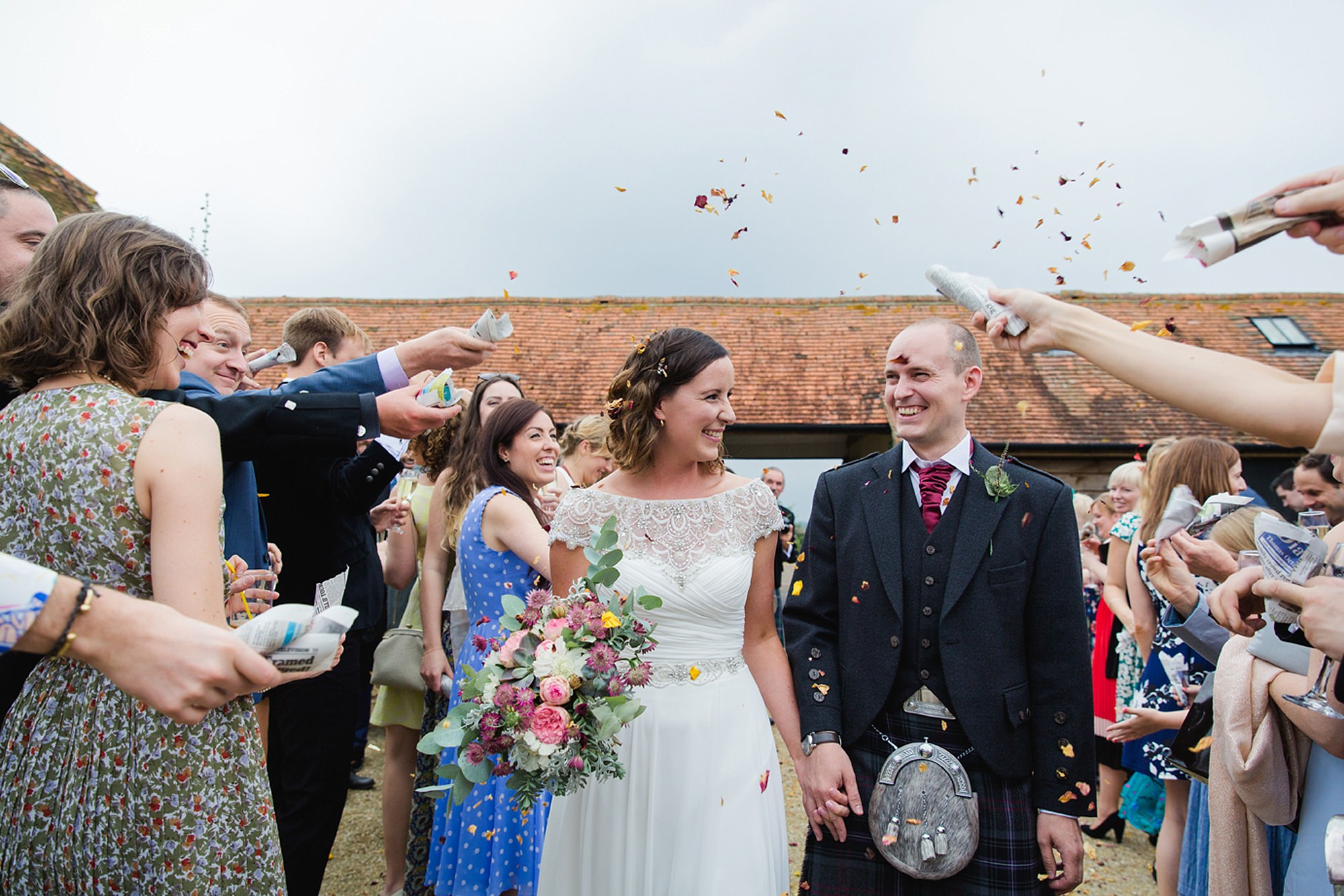 outdoor humanist wedding photography bride groom and confetti