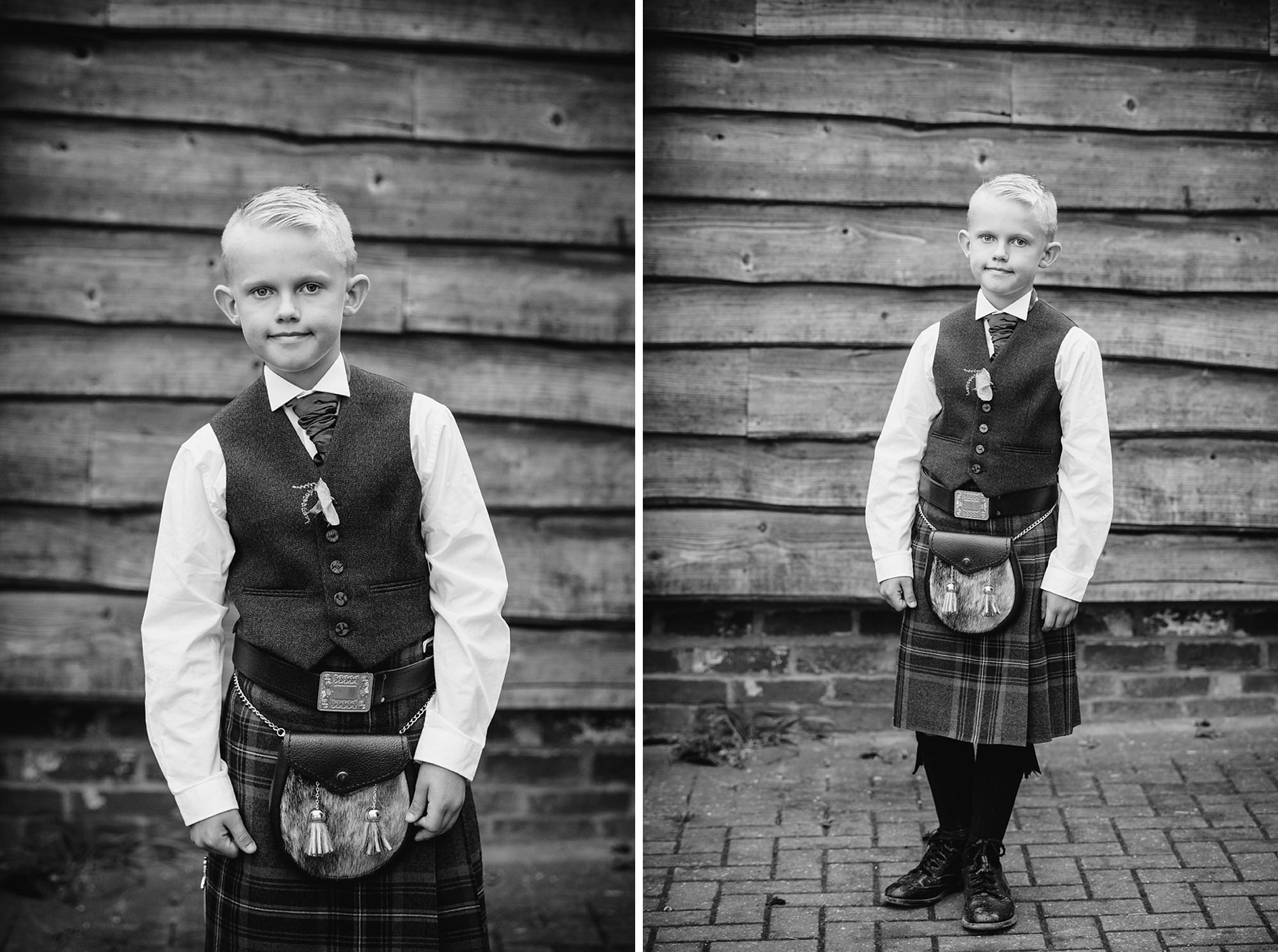 outdoor humanist wedding photography portrait of young lad in scottish attire