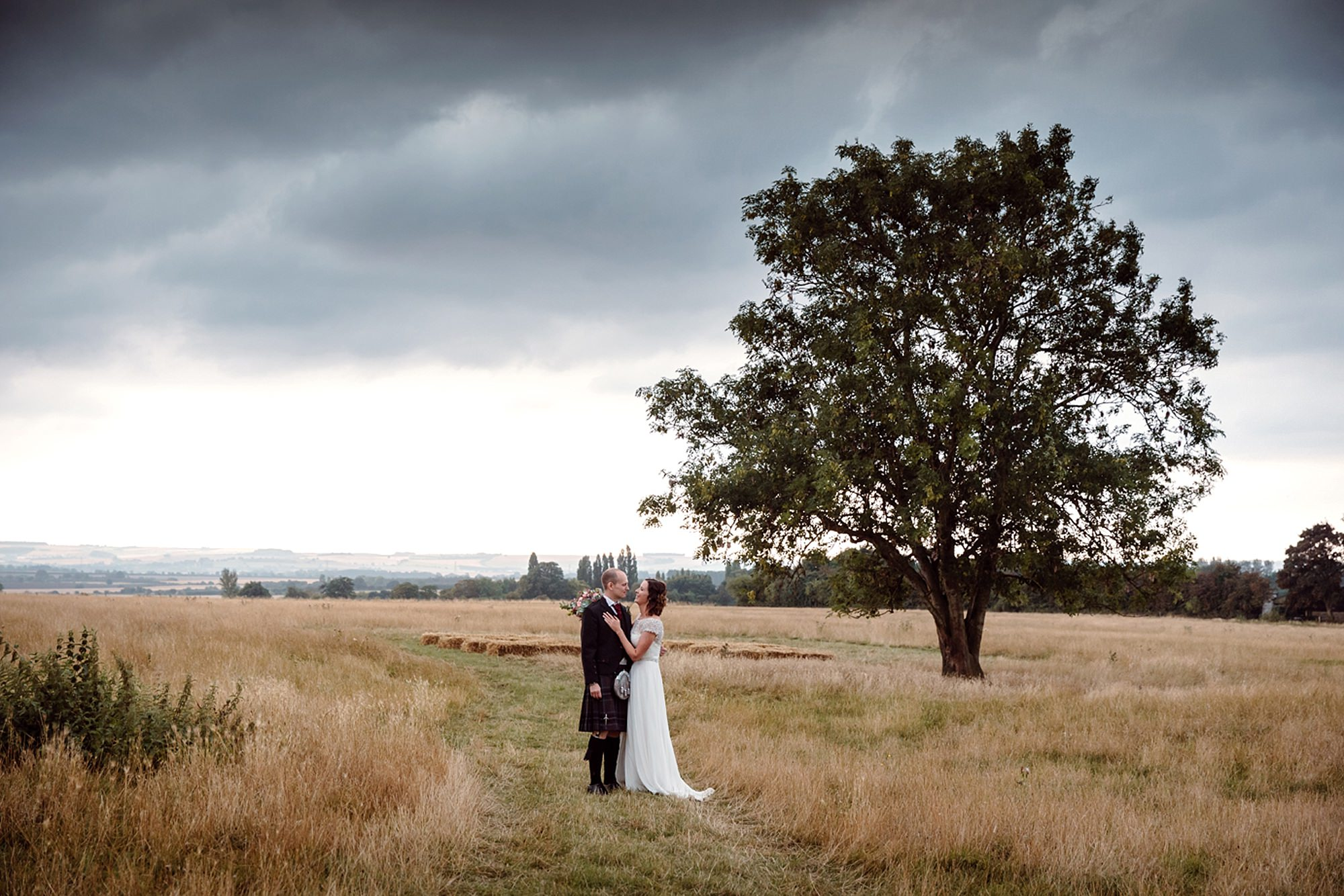 outdoor humanist wedding photography bride and groom under tree
