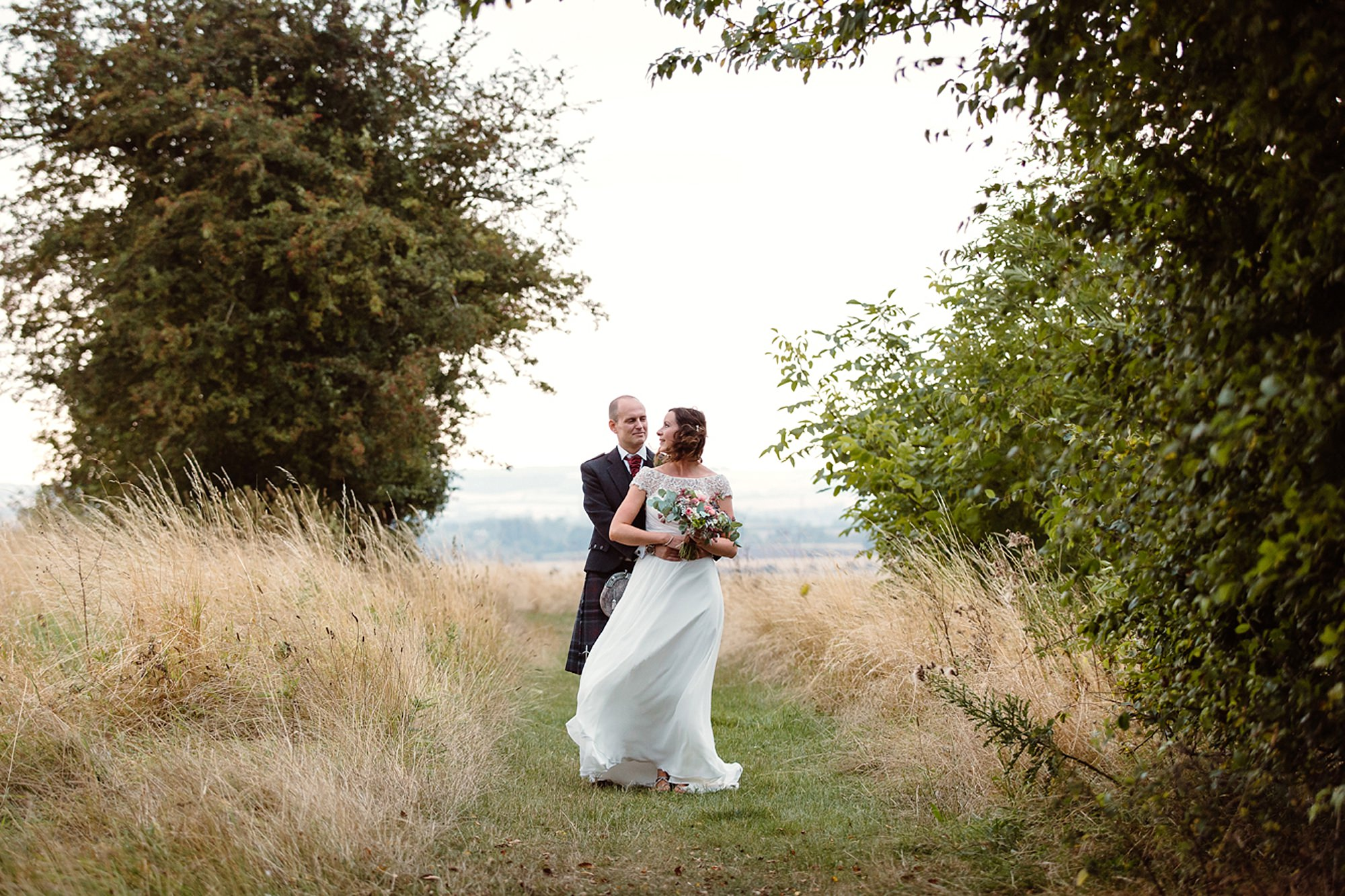 outdoor humanist wedding photography bride and grooming field
