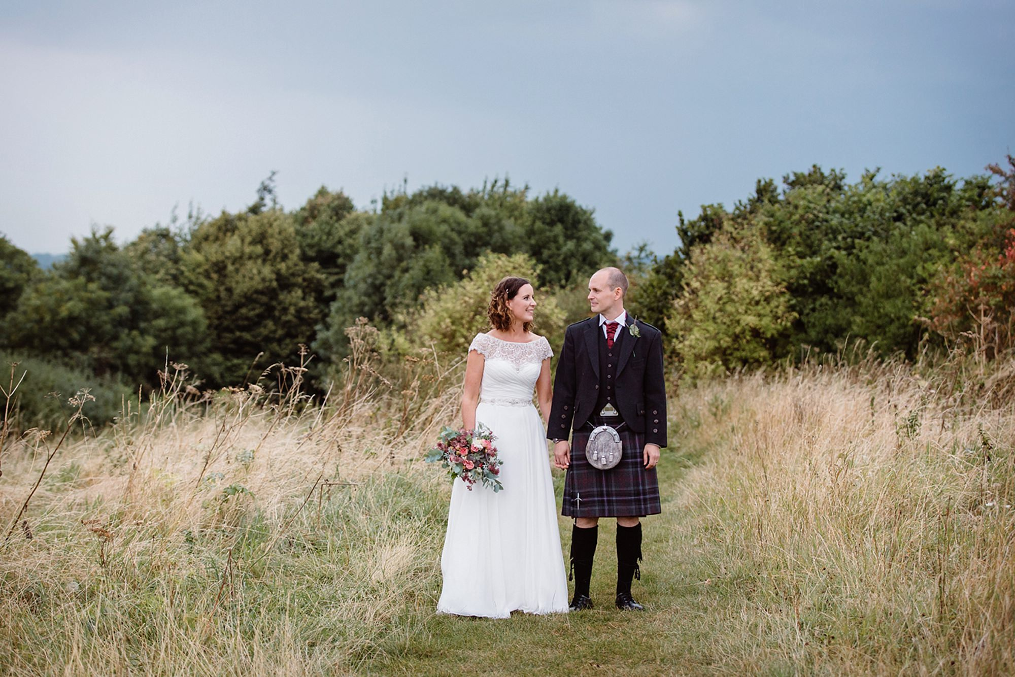 outdoor humanist wedding photography bride and groom together in field