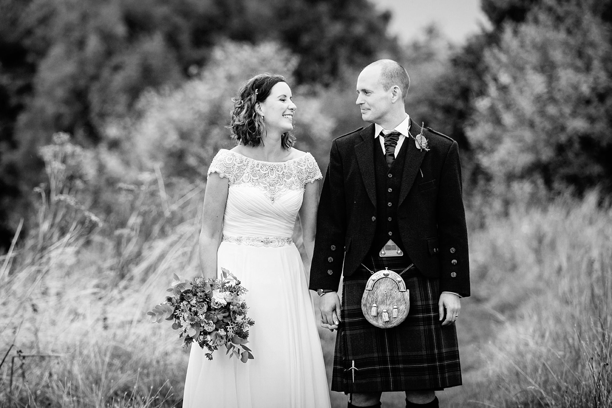 outdoor humanist wedding photography bride and groom laughing