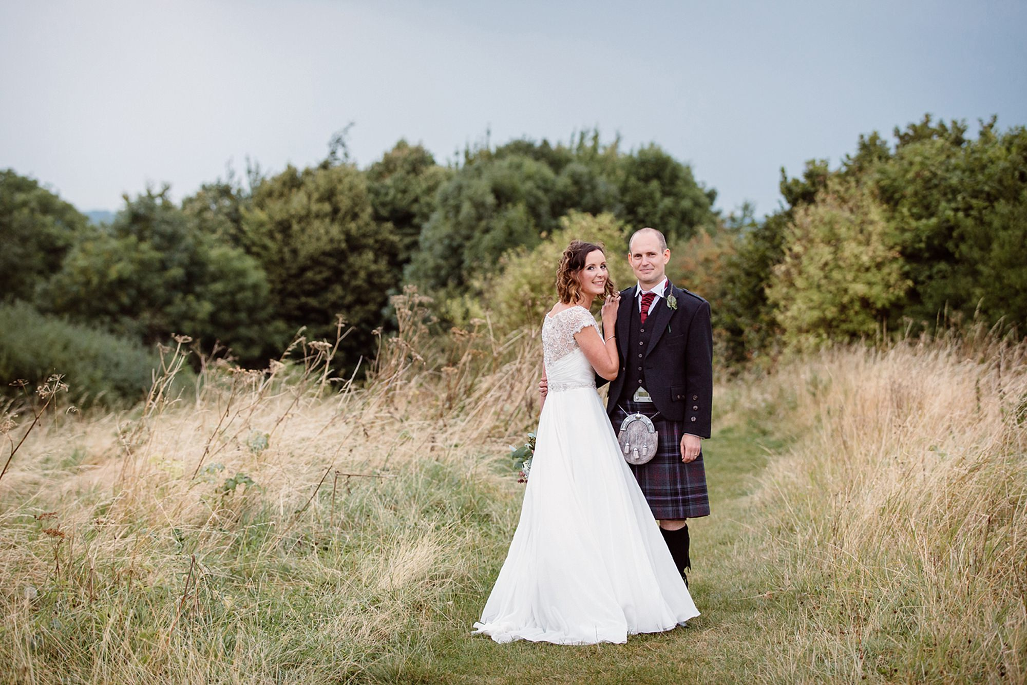 outdoor humanist wedding photography bride ad groom together