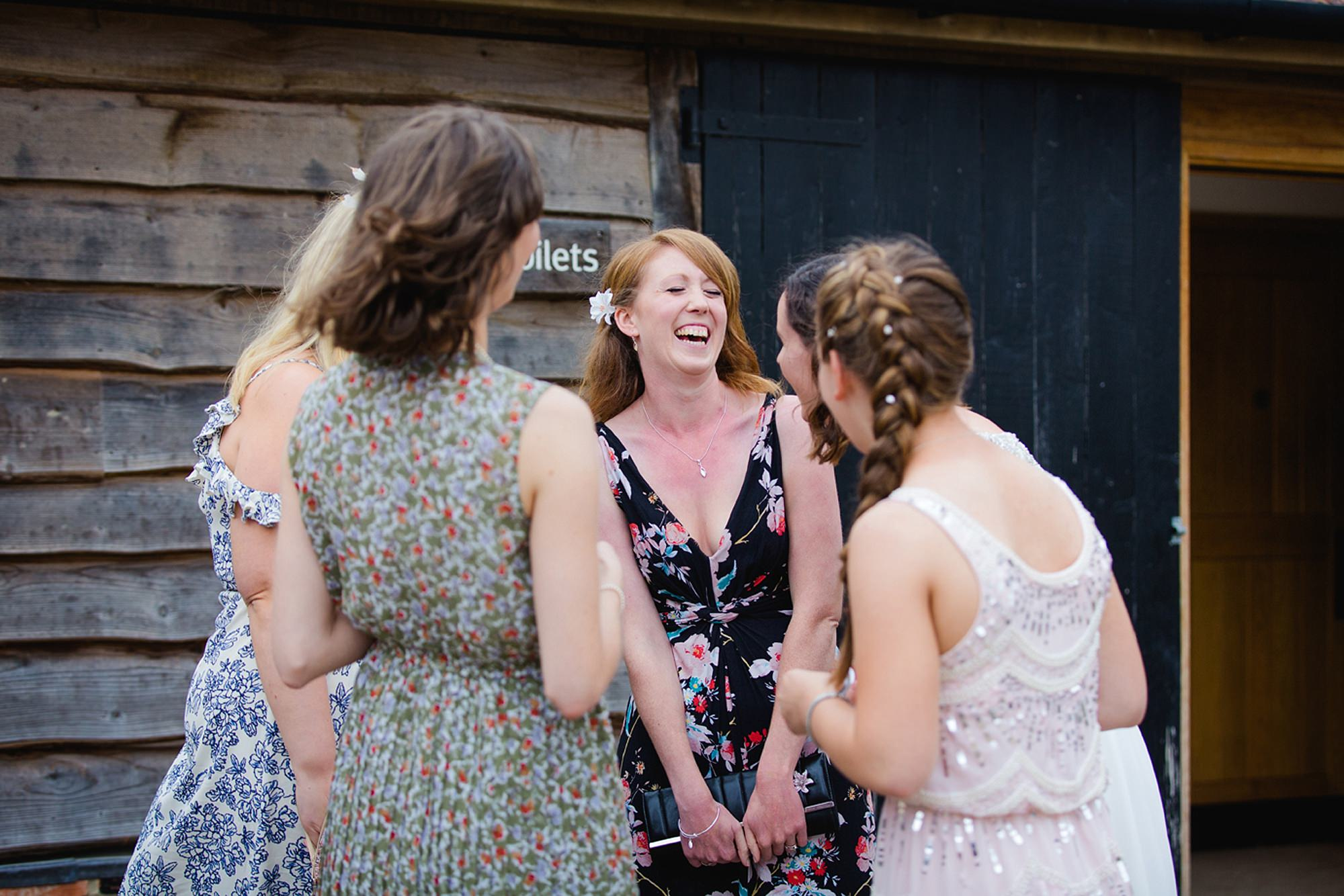 outdoor humanist wedding photography laughing guests