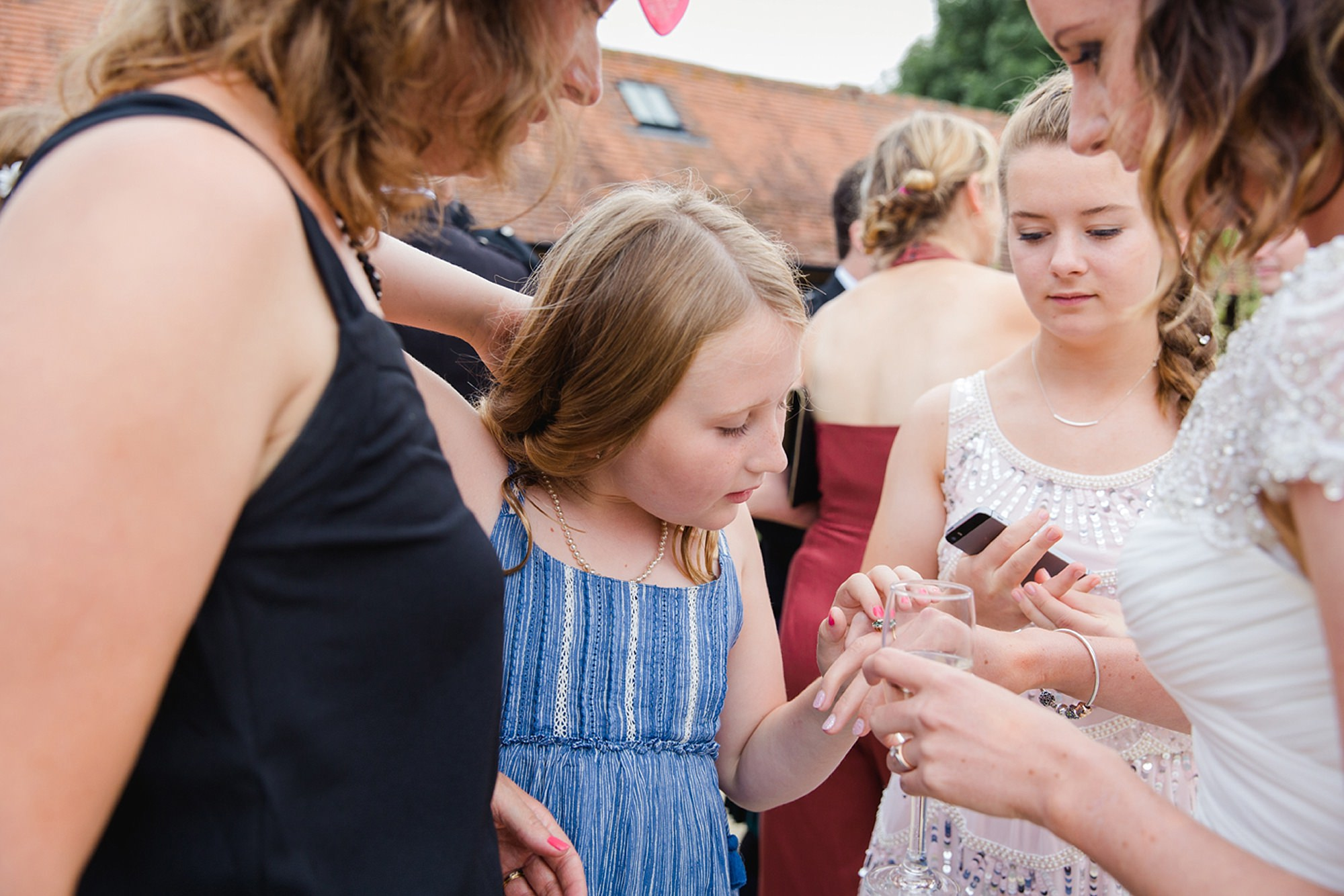 outdoor humanist wedding photography bride shows off ring
