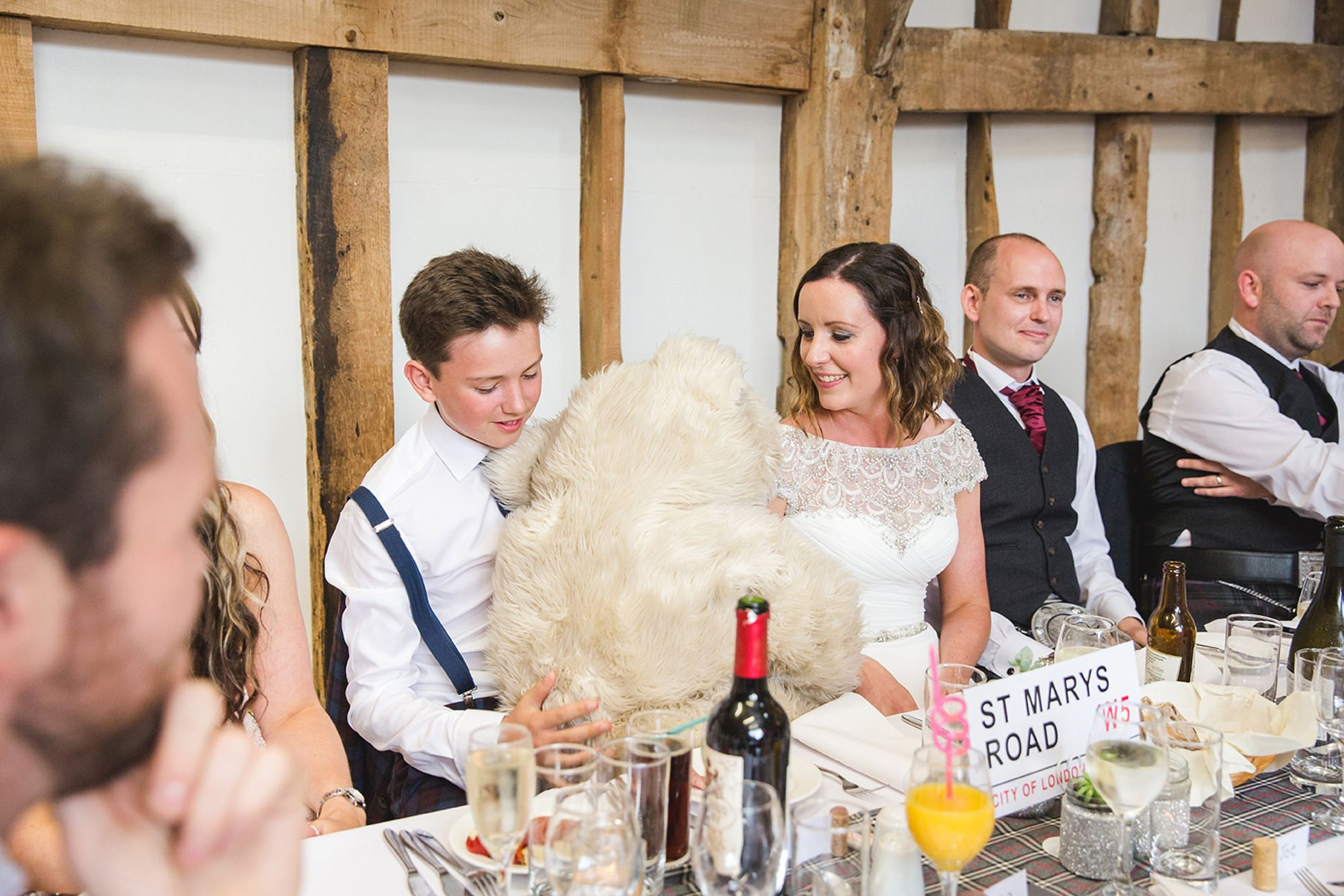 outdoor humanist wedding photography bride with giant teddy bear