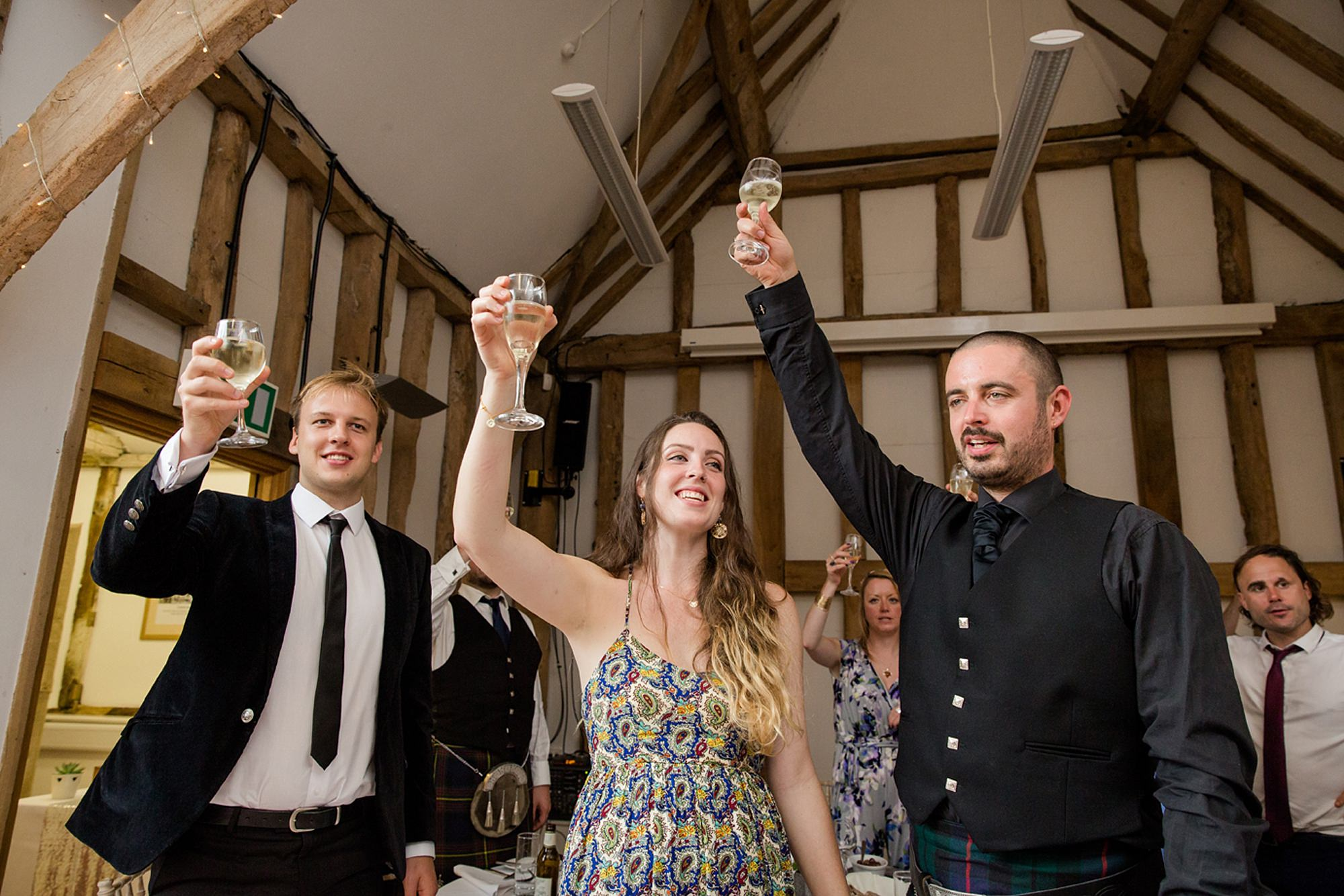 outdoor humanist wedding photography wedding guests toasting