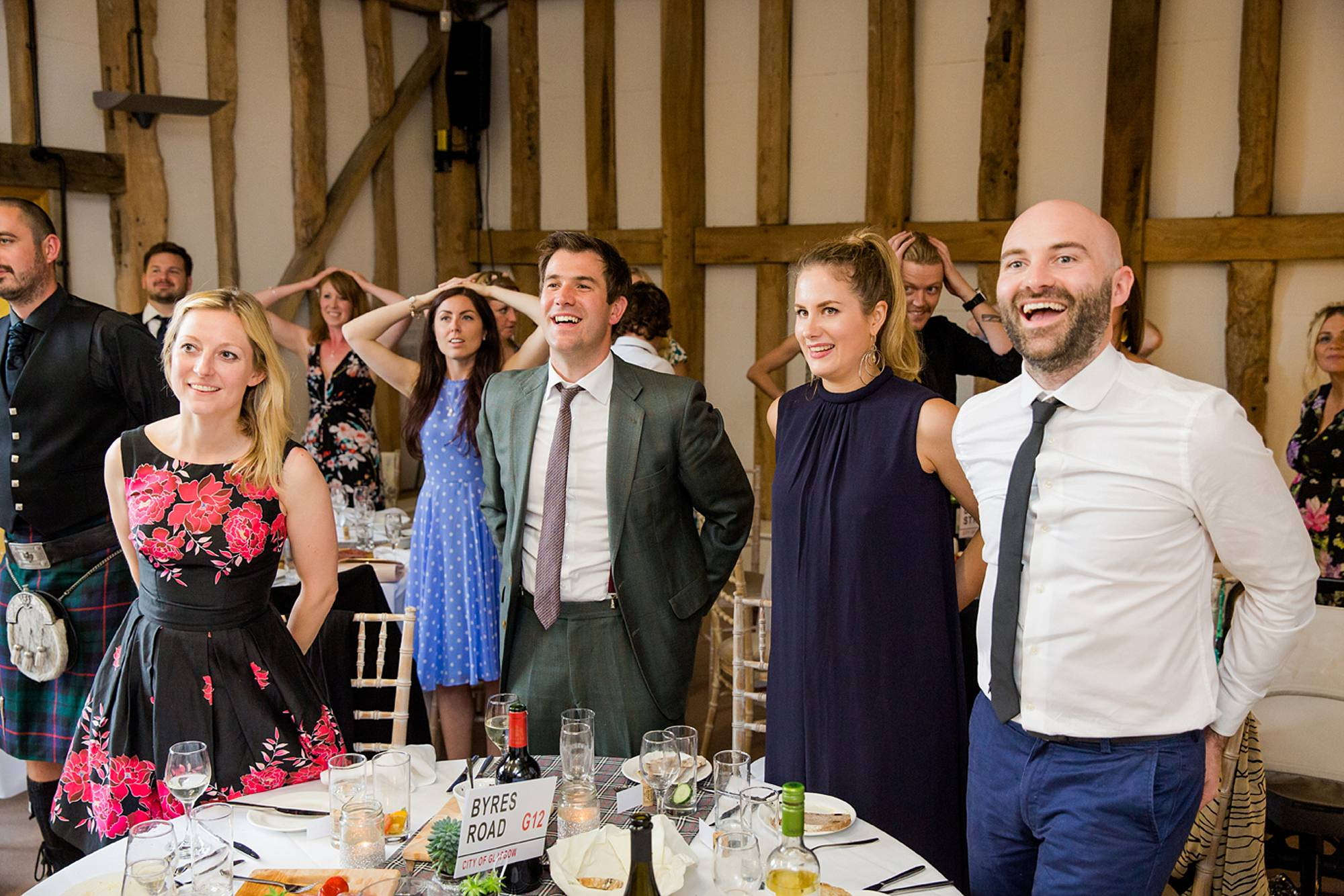 outdoor humanist wedding photography wedding guests laughing