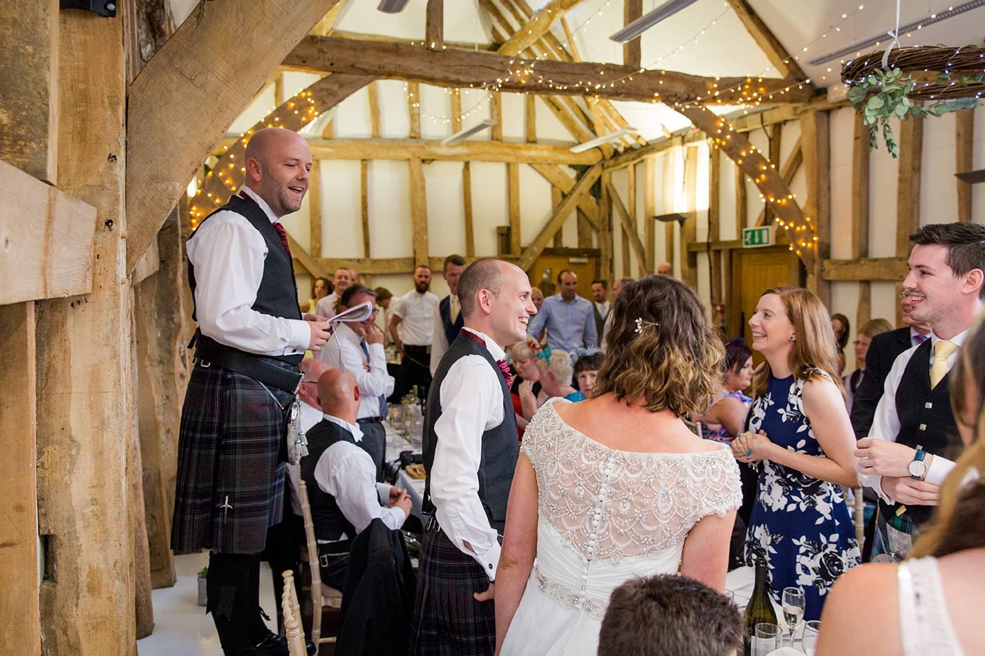outdoor humanist wedding photography groom during best man speech