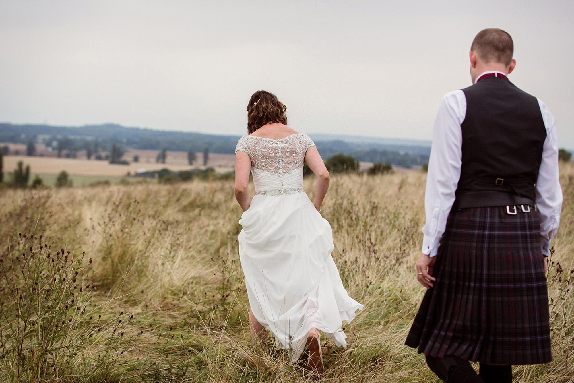 outdoor humanist wedding photography bride walking through grass