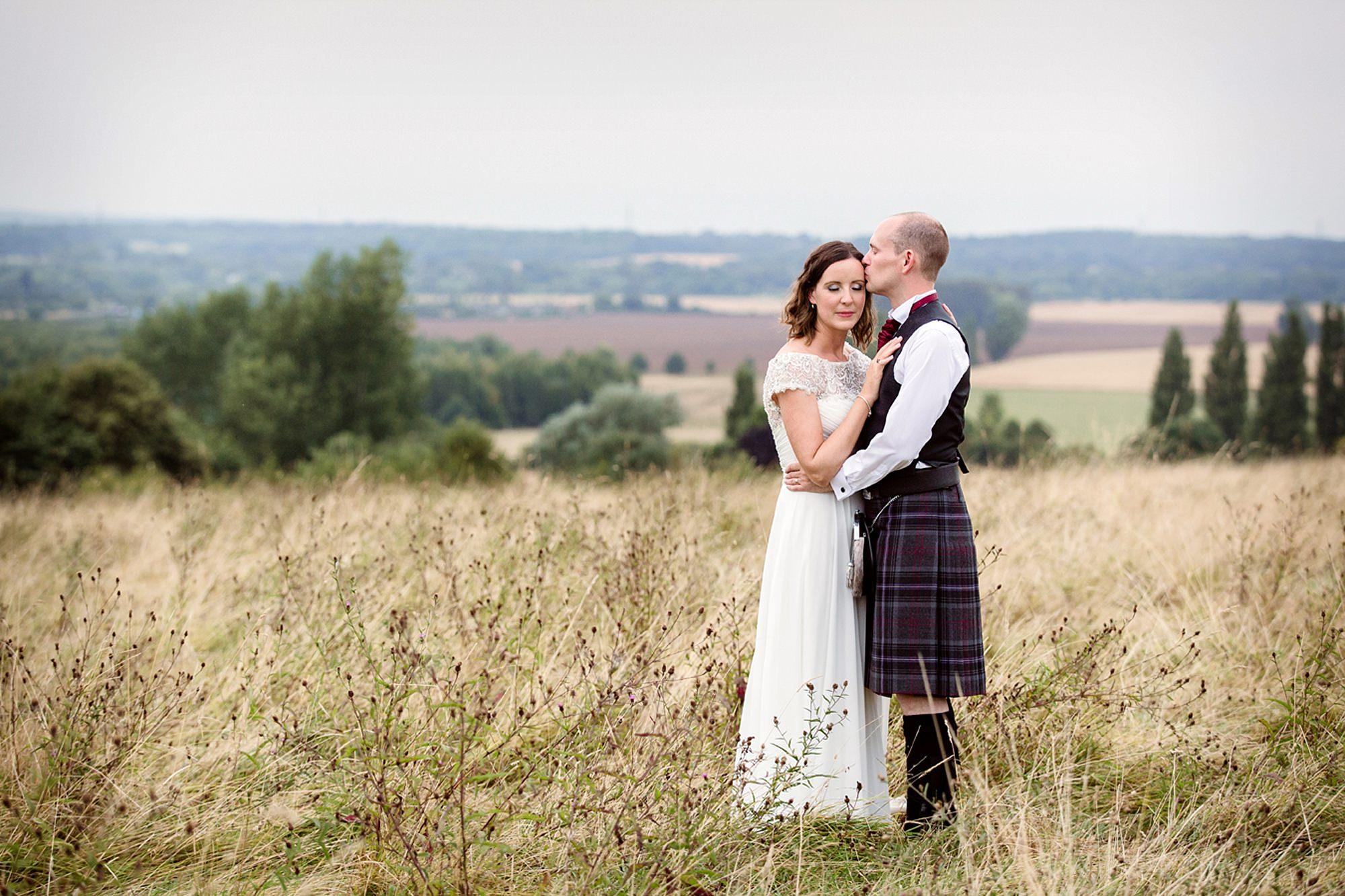 outdoor humanist wedding photography groom kissing bride
