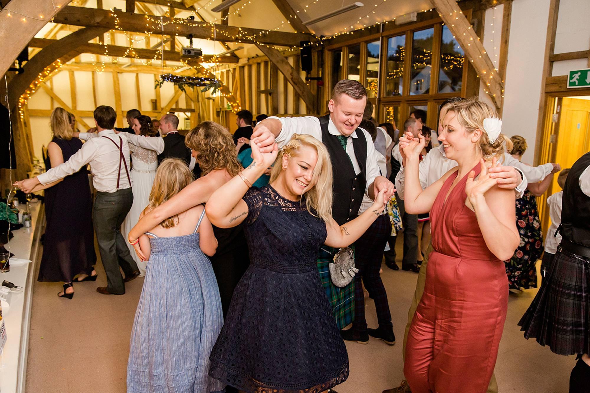 Outdoor humanist wedding photography wedding guests dancing