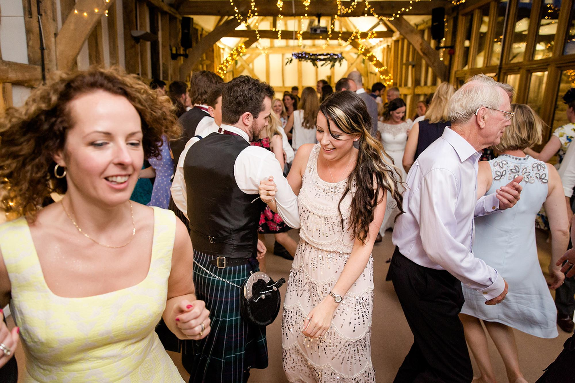 Outdoor humanist wedding photography guest ceilidh dancing
