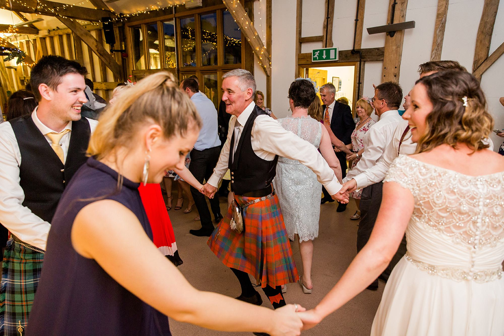 Outdoor humanist wedding photography wedding ceilidh