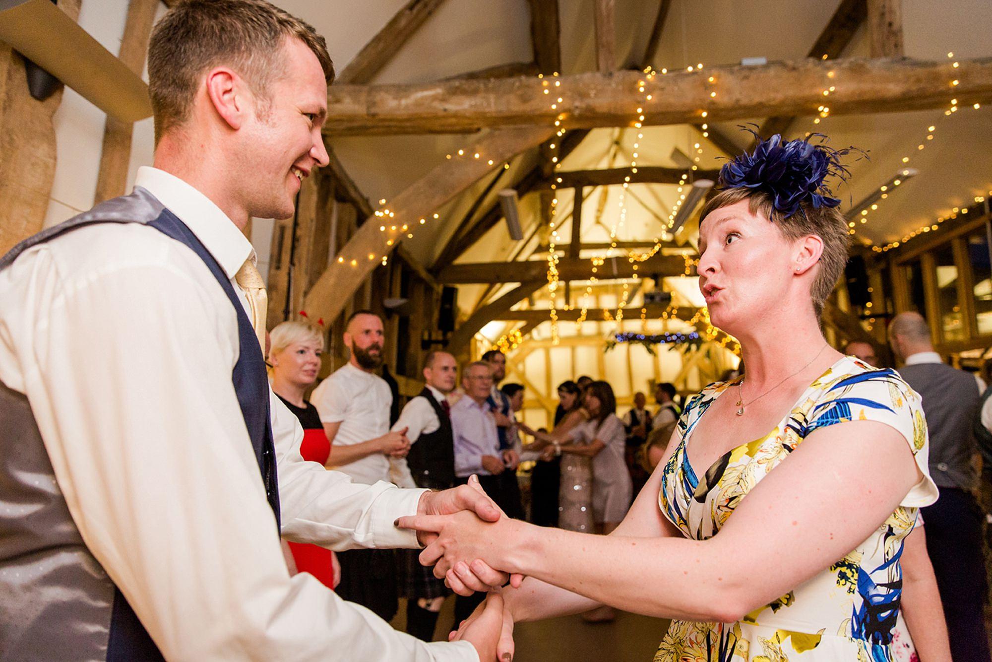 Outdoor humanist wedding photography guests dancing