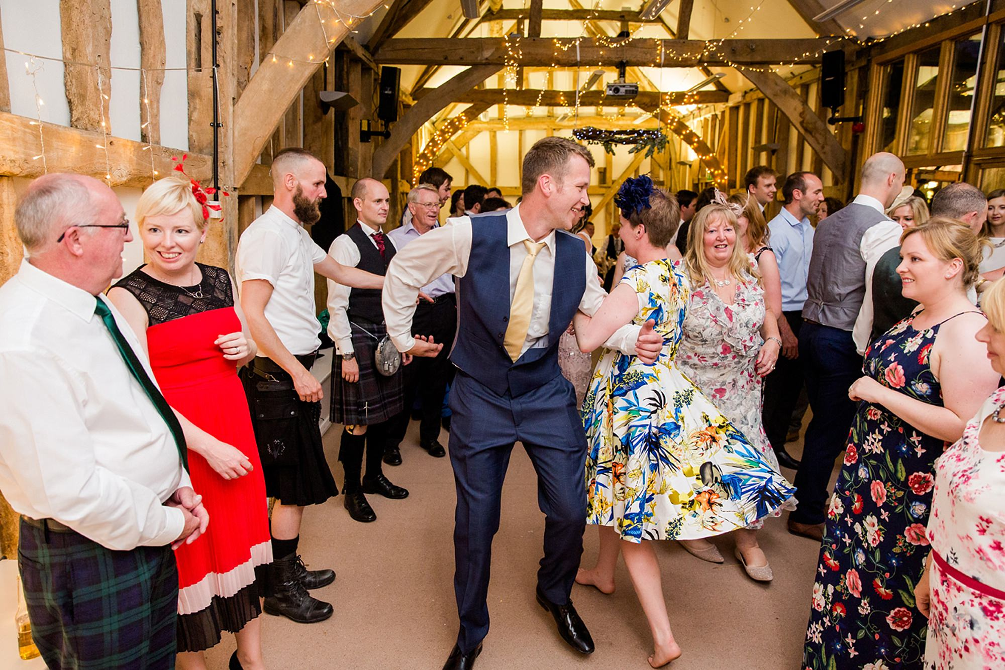 Outdoor humanist wedding photography fun guest ceilidh