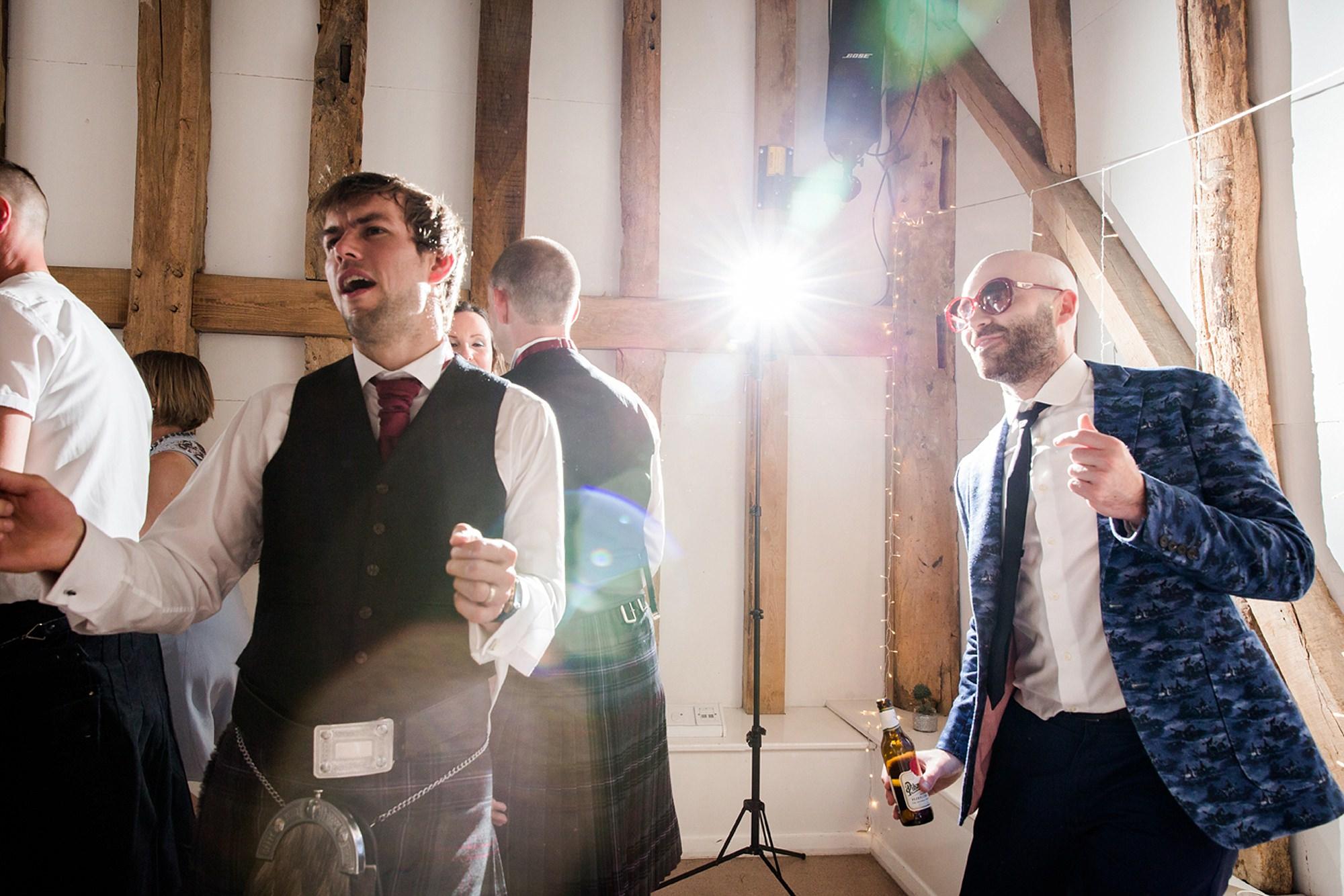 Outdoor humanist wedding photography fun guests dancing
