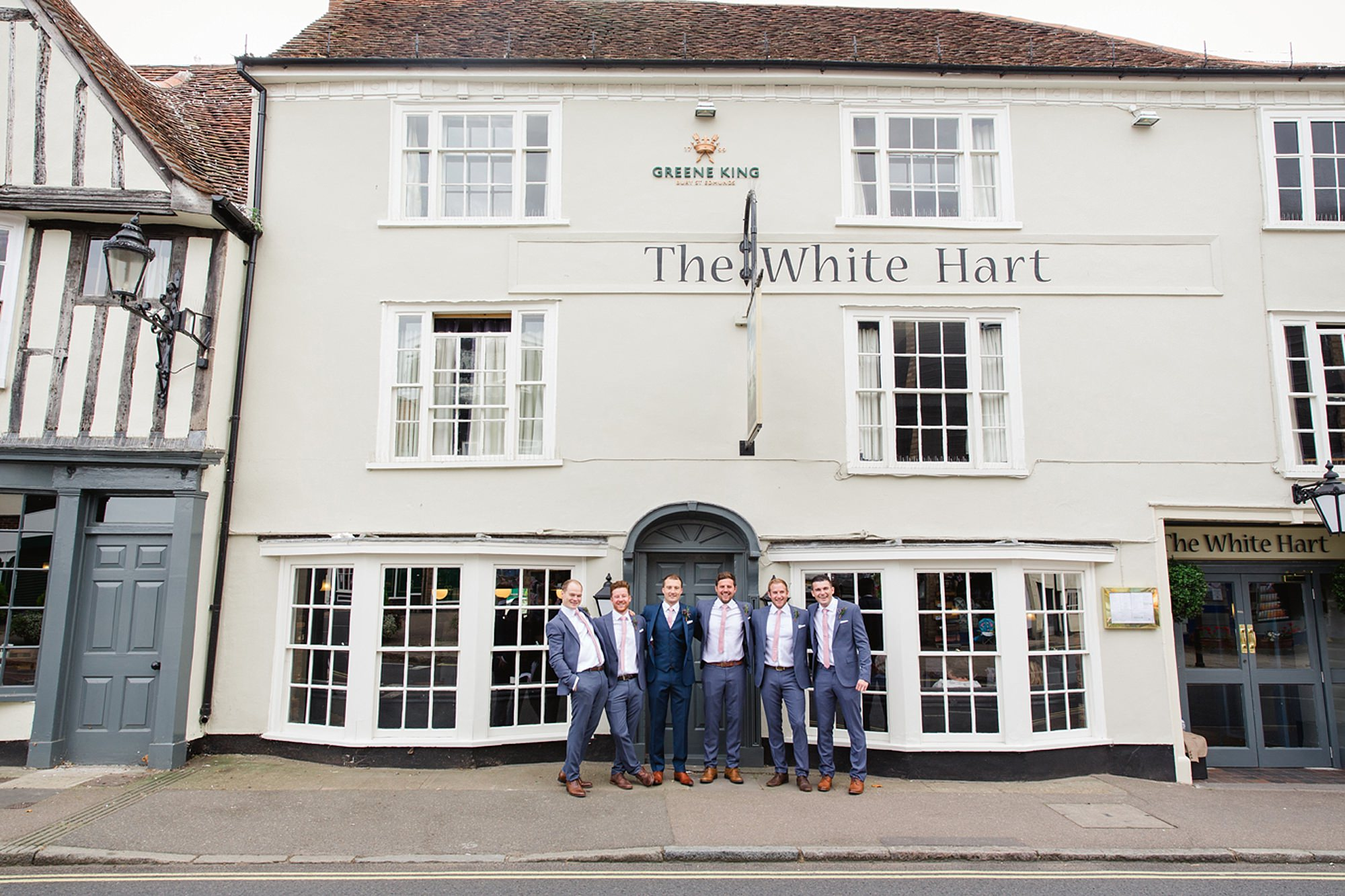 Marks Hall Estate wedding photography groom and groomsmen outside the pub