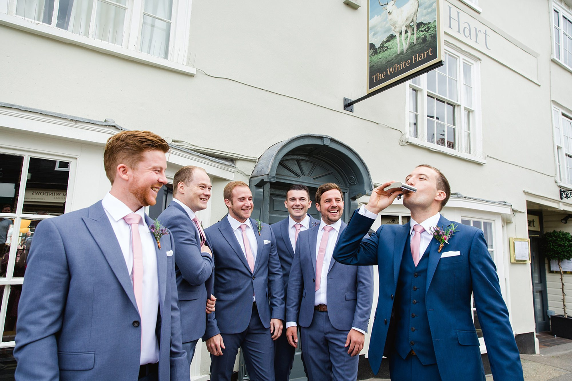 Marks Hall Estate wedding photography groom and groomsmen with hip flask