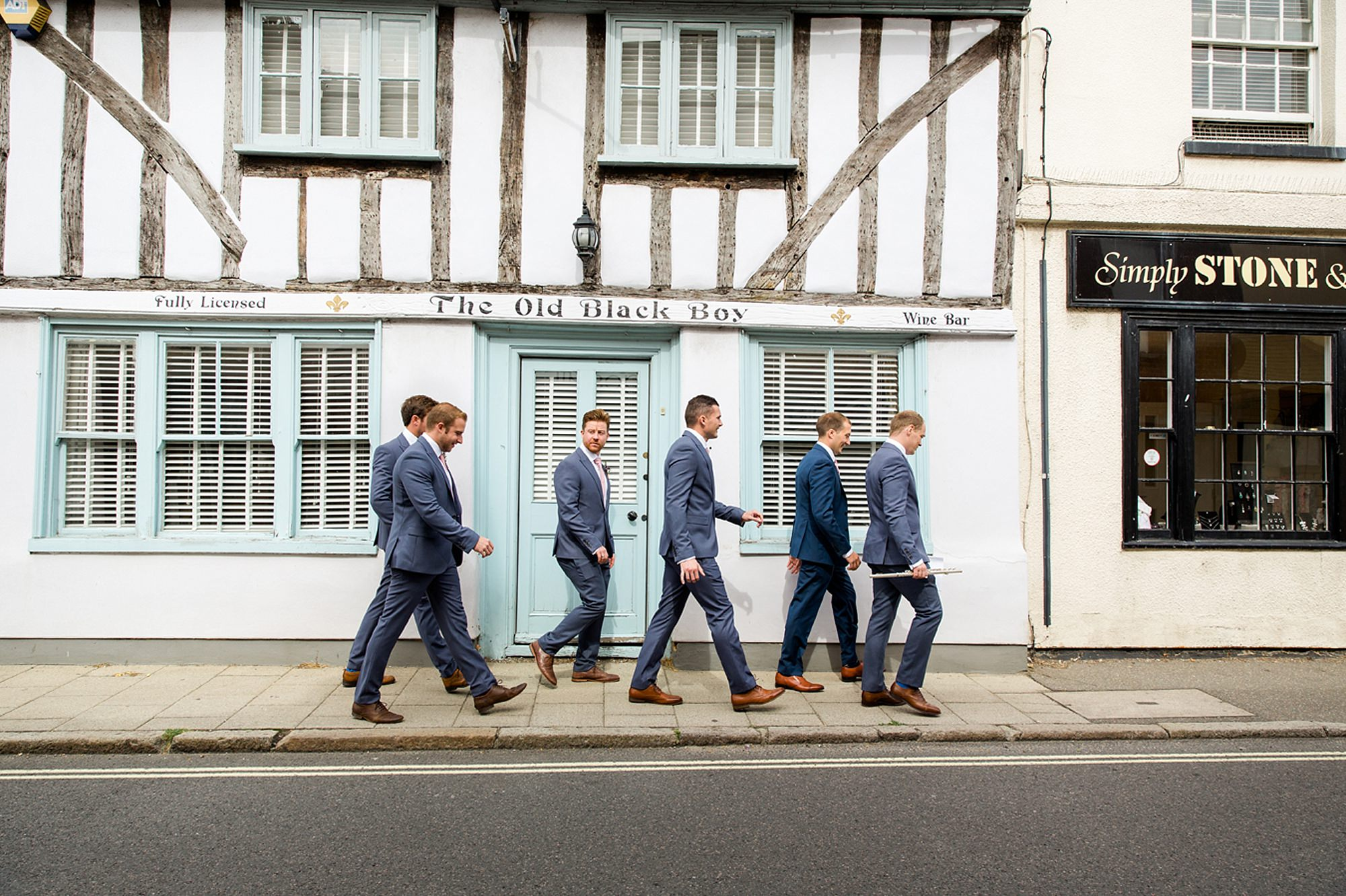 Marks Hall Estate wedding photography groom's party walking to church