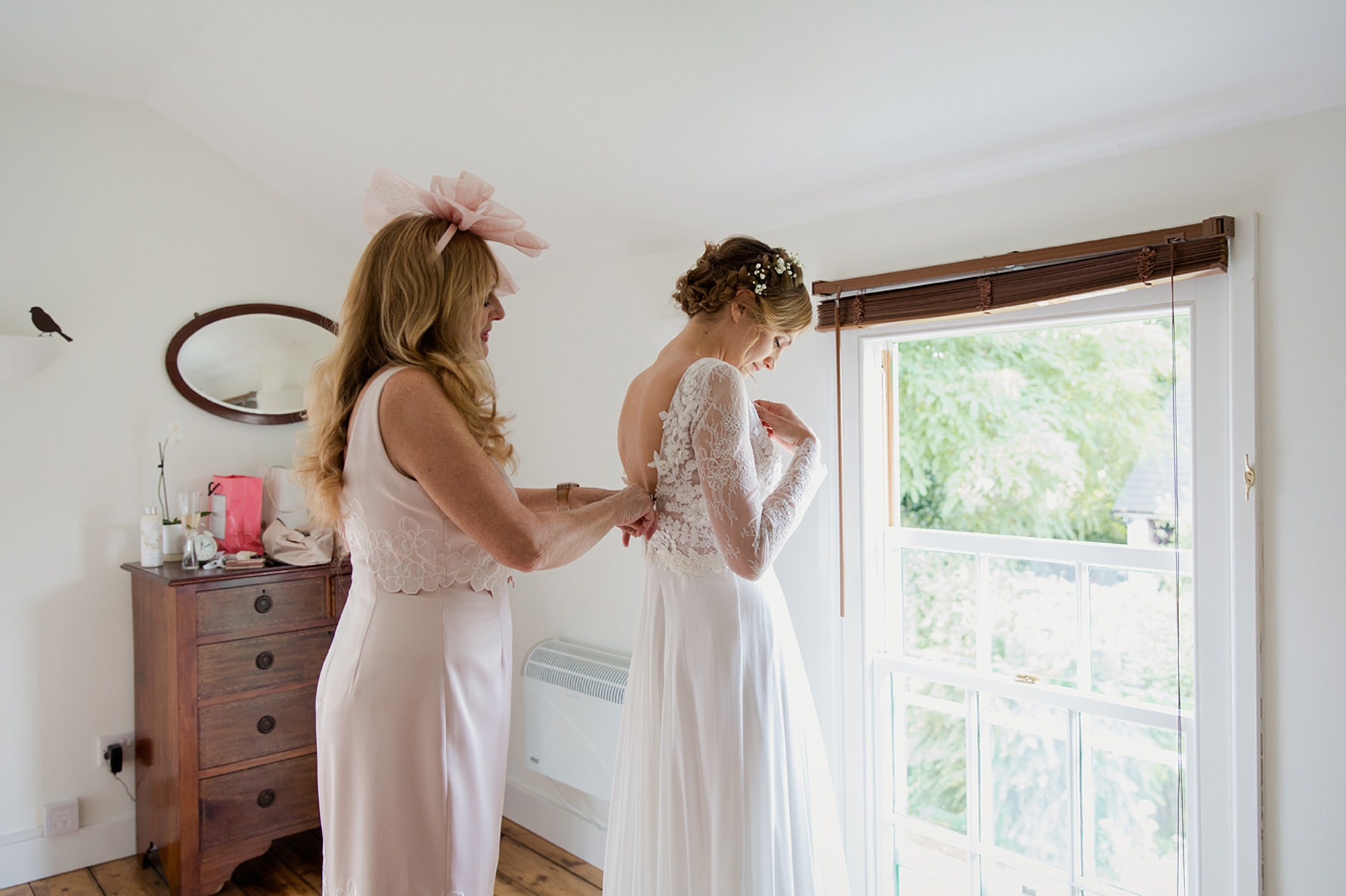 Marks Hall Estate wedding photography bride getting into dress