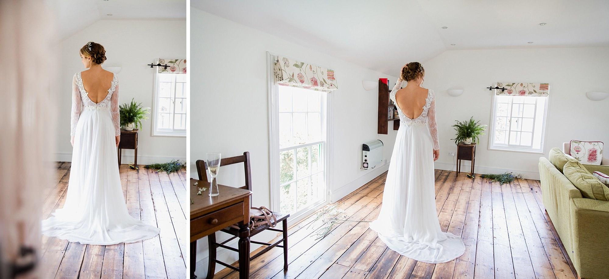 Marks Hall Estate wedding photography bride showing off her dress