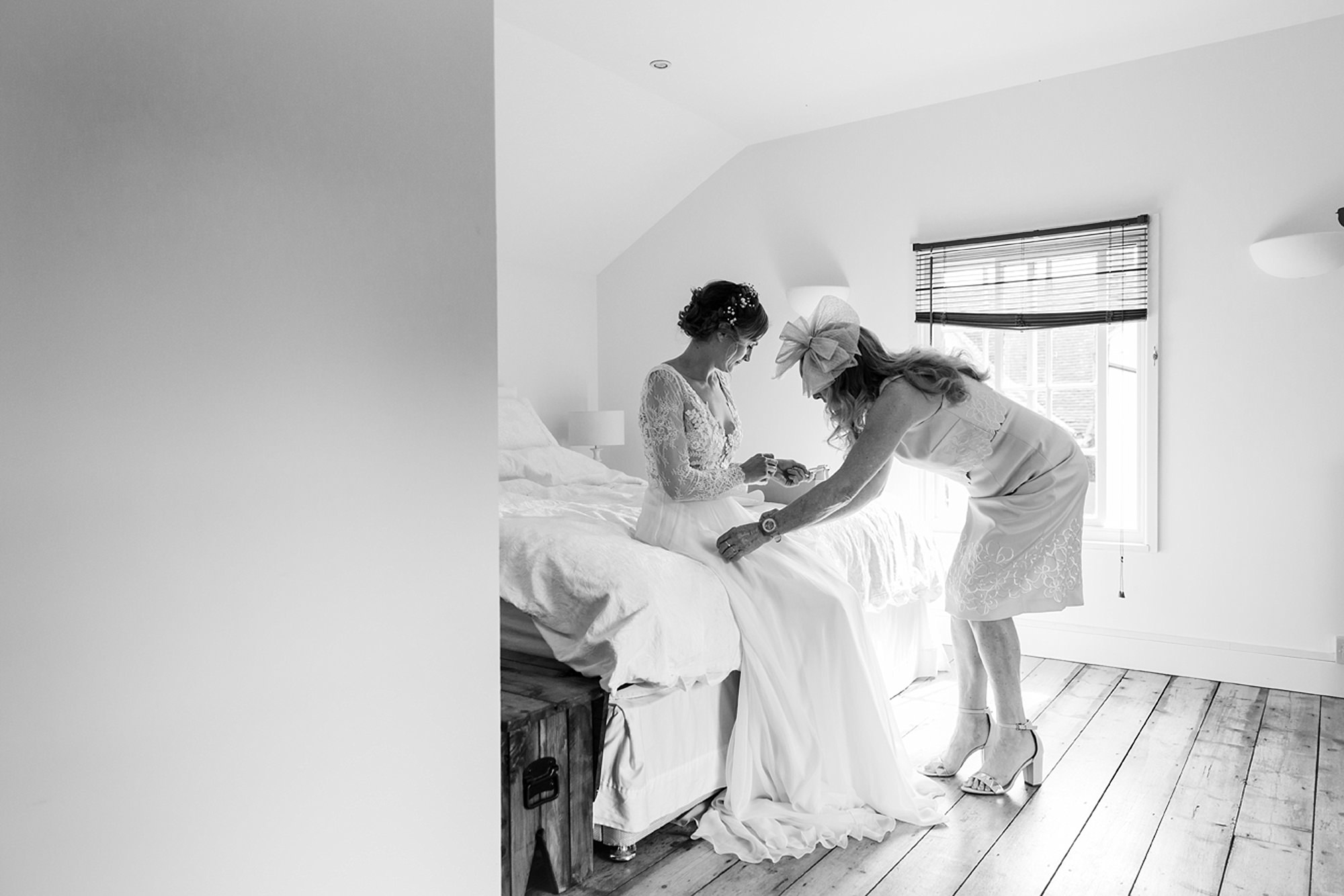 Marks Hall Estate wedding photography bride's mum helping get ready