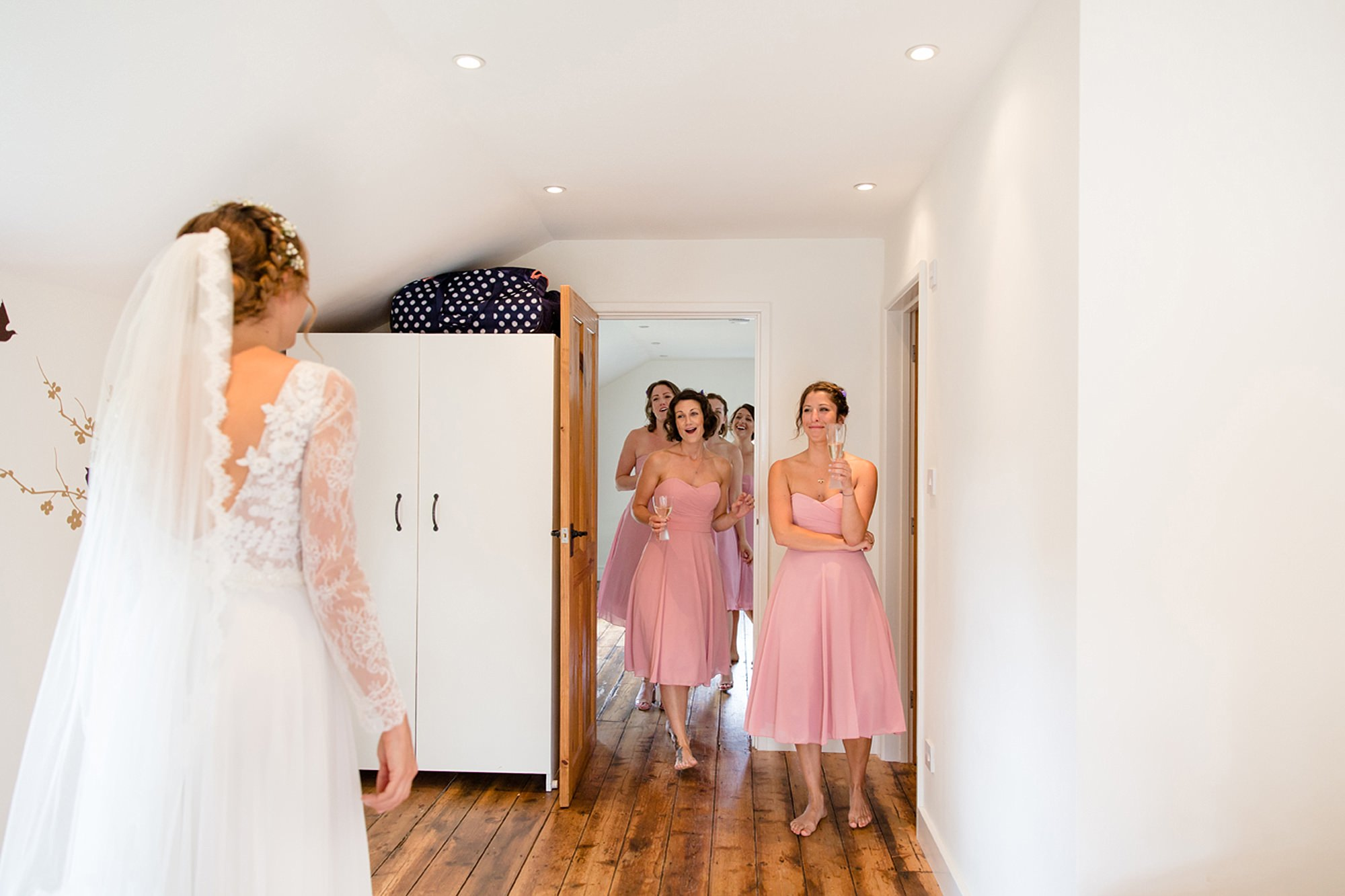 Marks Hall Estate wedding photography bridesmaids see bride in her dress