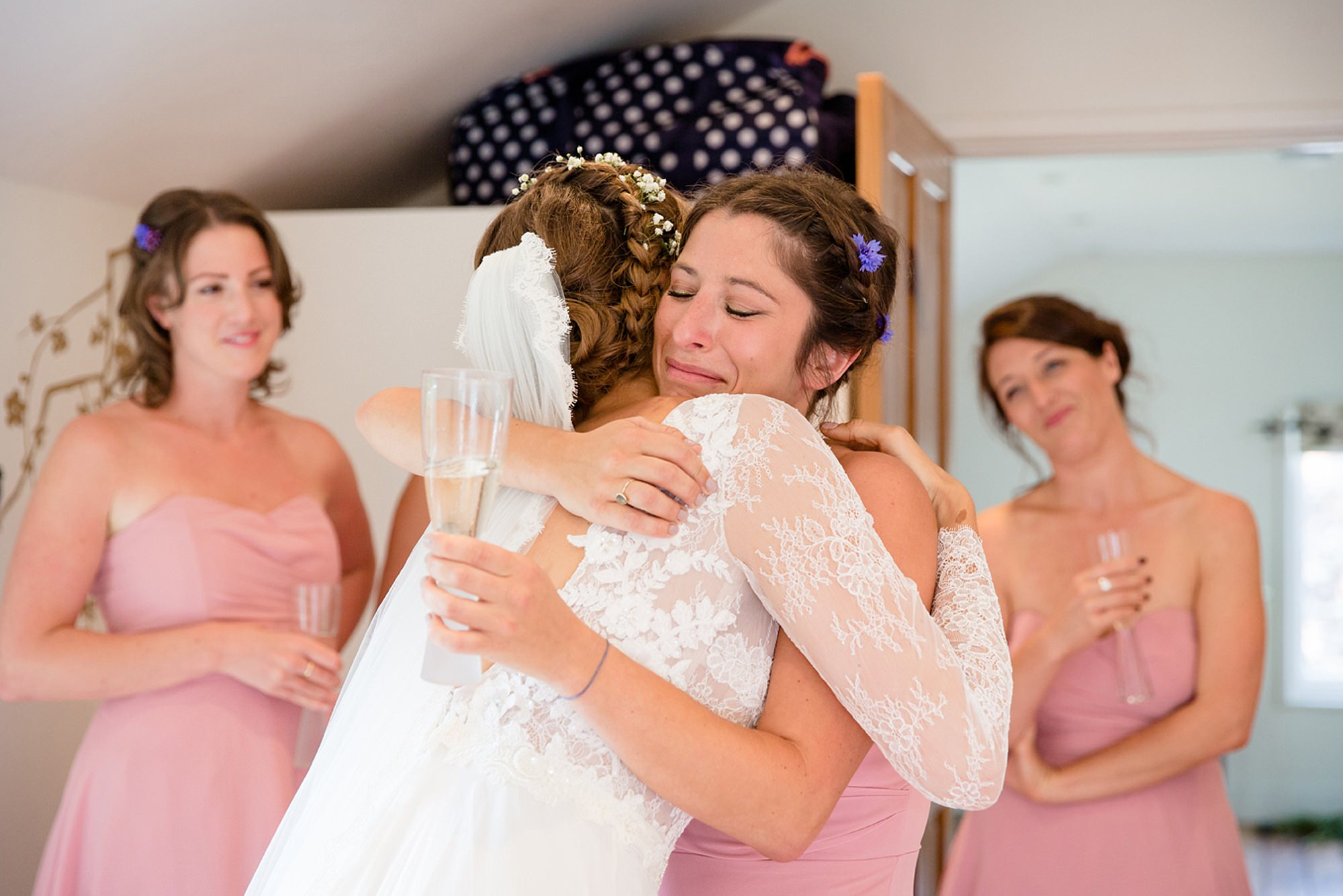 Marks Hall Estate wedding photography bridesmaid hugging bride