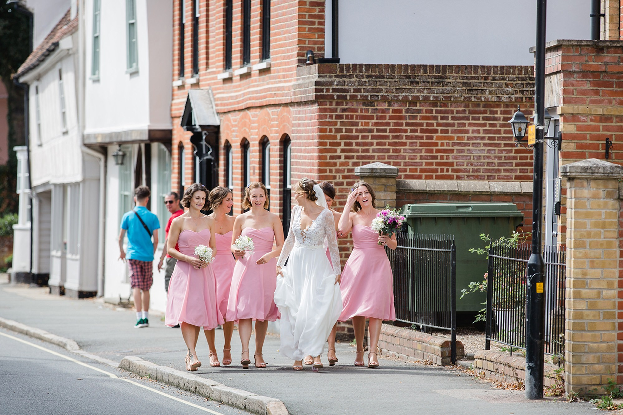Marks Hall Estate wedding photography bride and bridesmaids walking