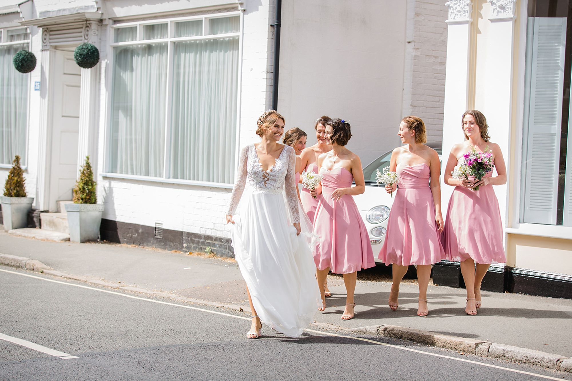 Marks Hall Estate wedding photography bridal party crossing the road