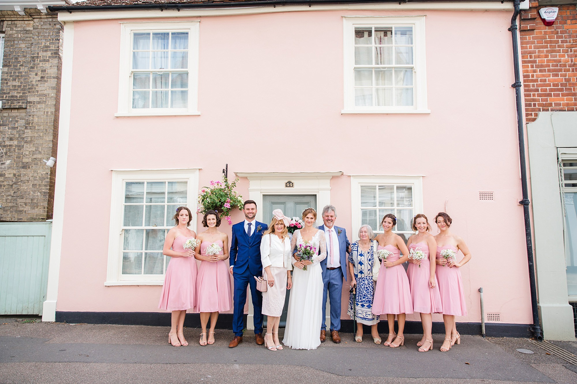 Marks Hall Estate wedding photography bride and her family by pink house