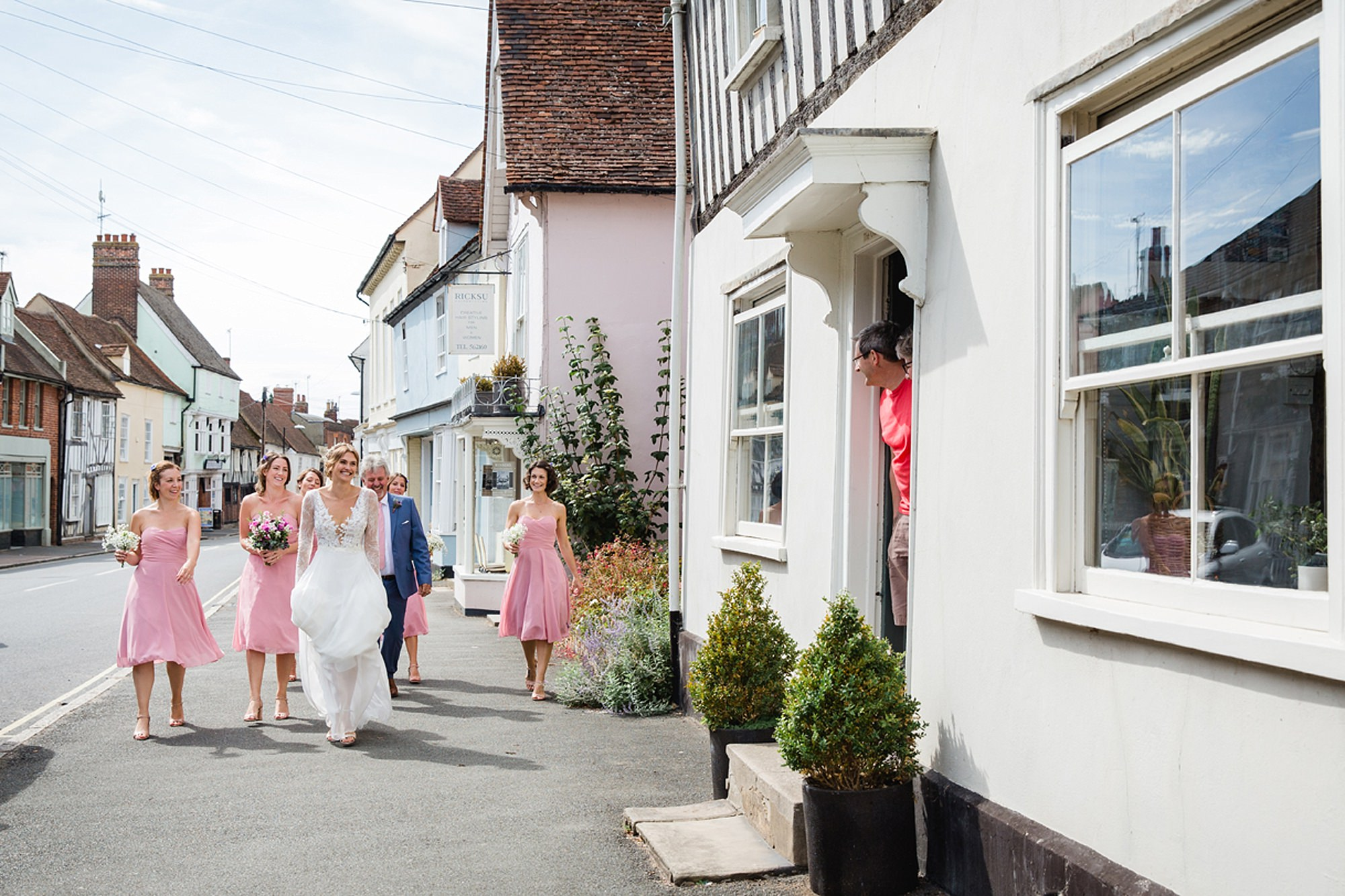 Marks Hall Estate wedding photography bride greeted by strangers in coggeshall village