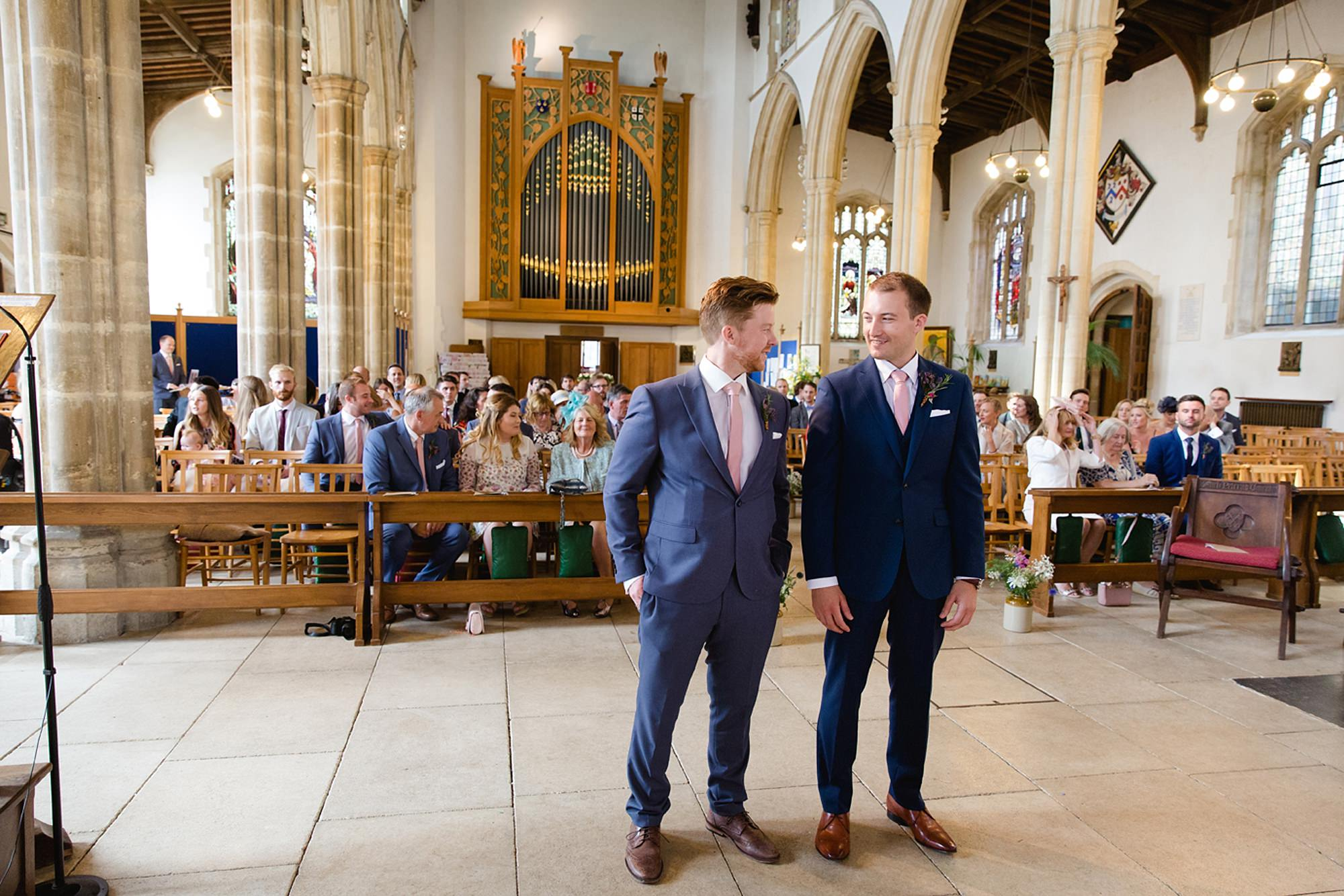 Marks Hall Estate wedding photography groom waiting for bride at church