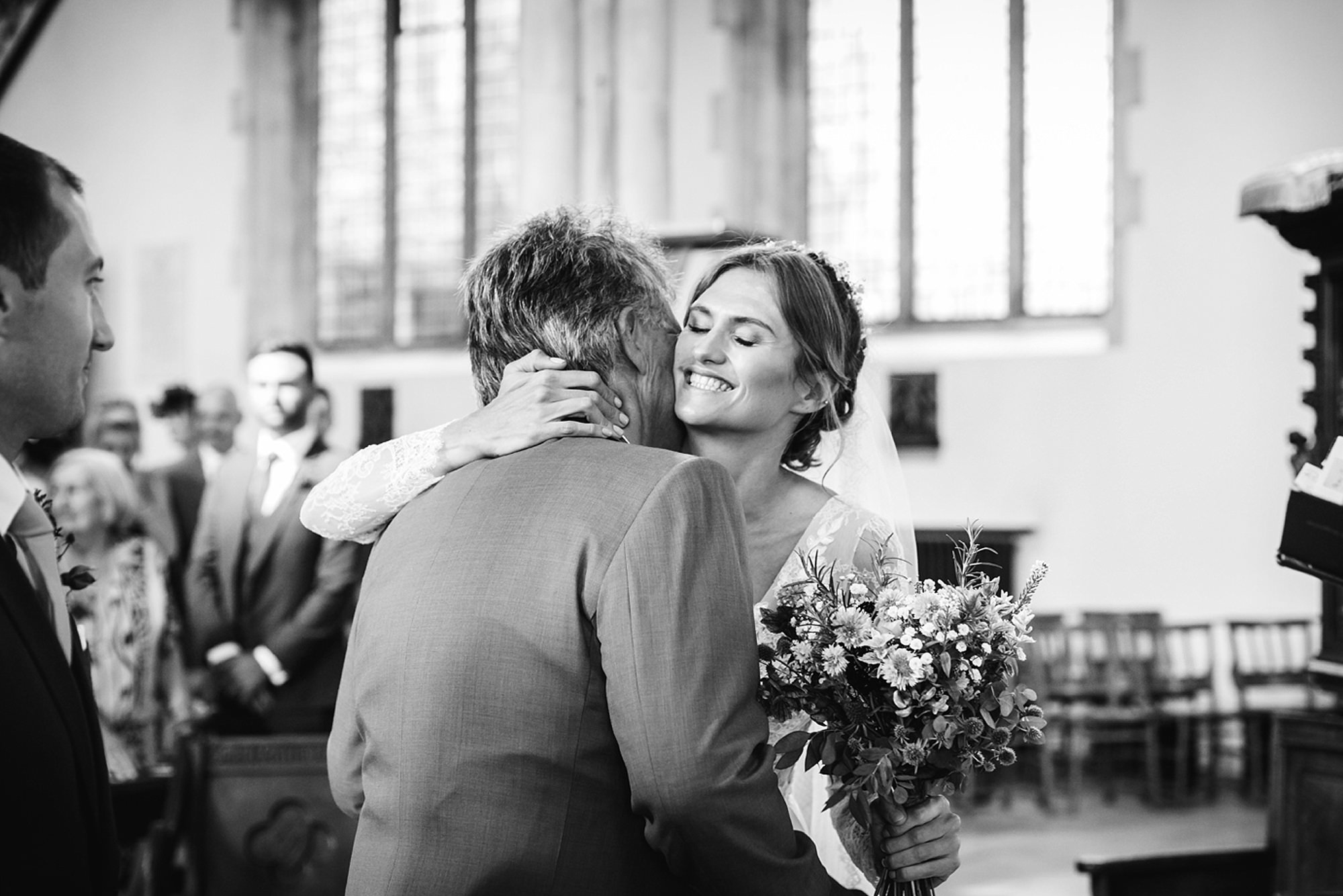 Marks Hall Estate wedding photography bride hugs her father