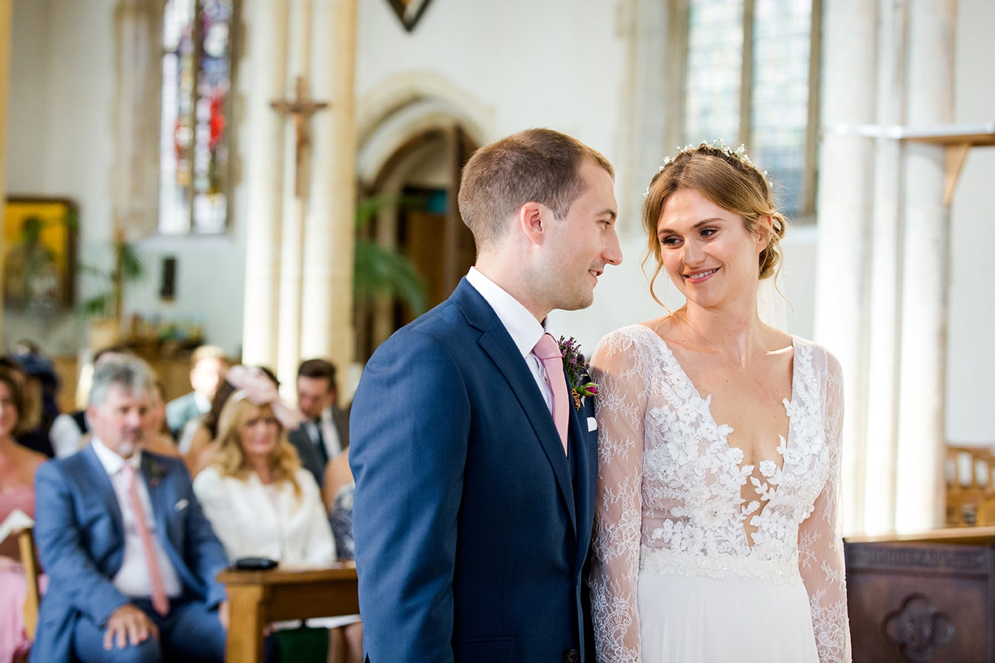 Marks Hall Estate wedding photography bride and groom smile during ceremony