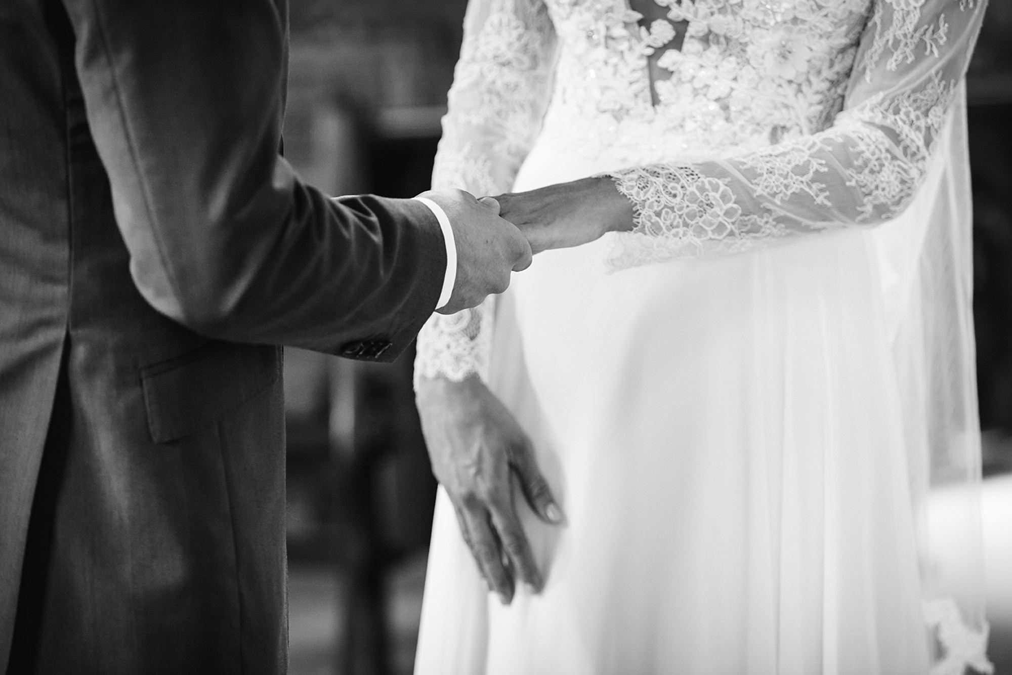 Marks Hall Estate wedding photography groom holds bride's hand